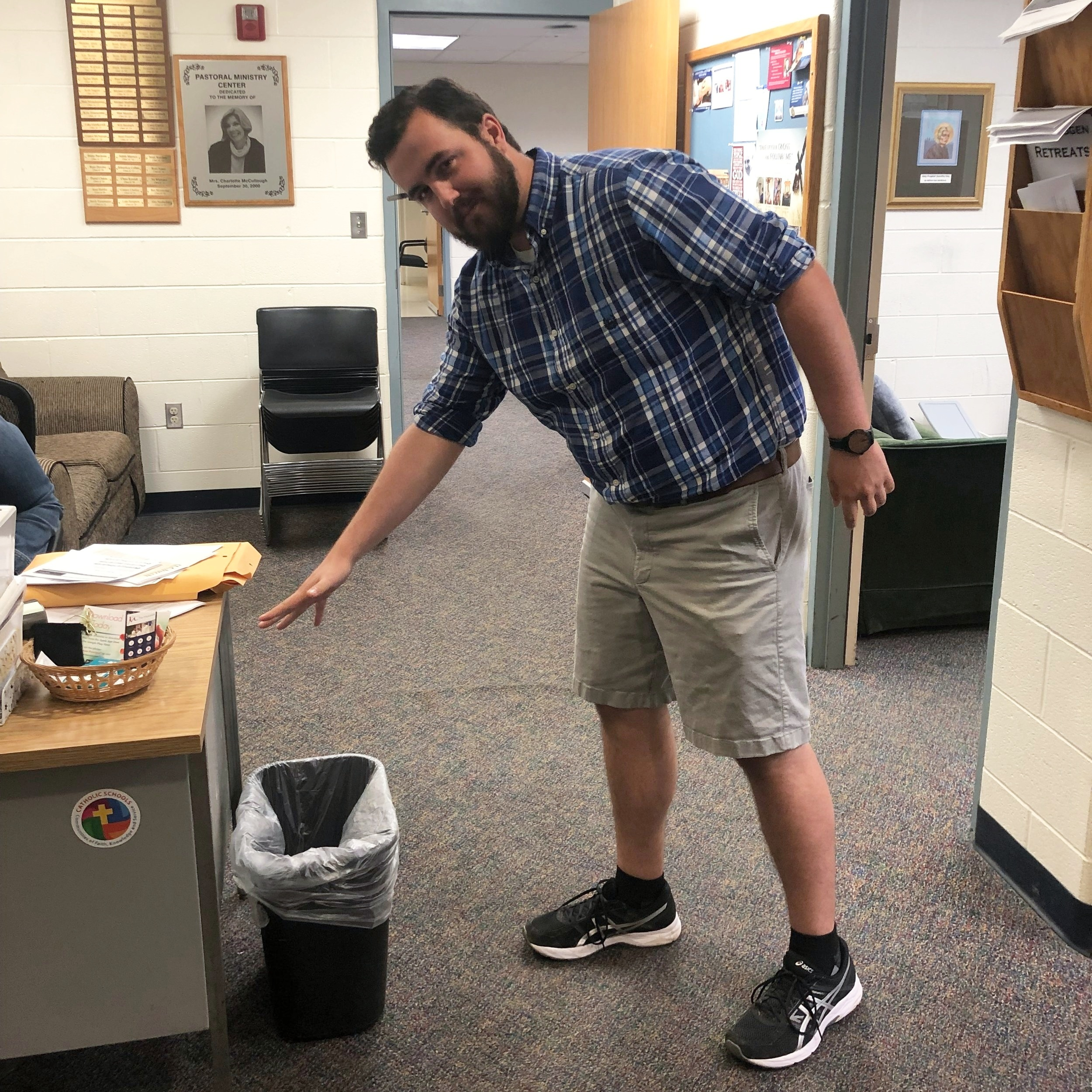 Mr. James tidying up the Campus Ministry Office  by James George