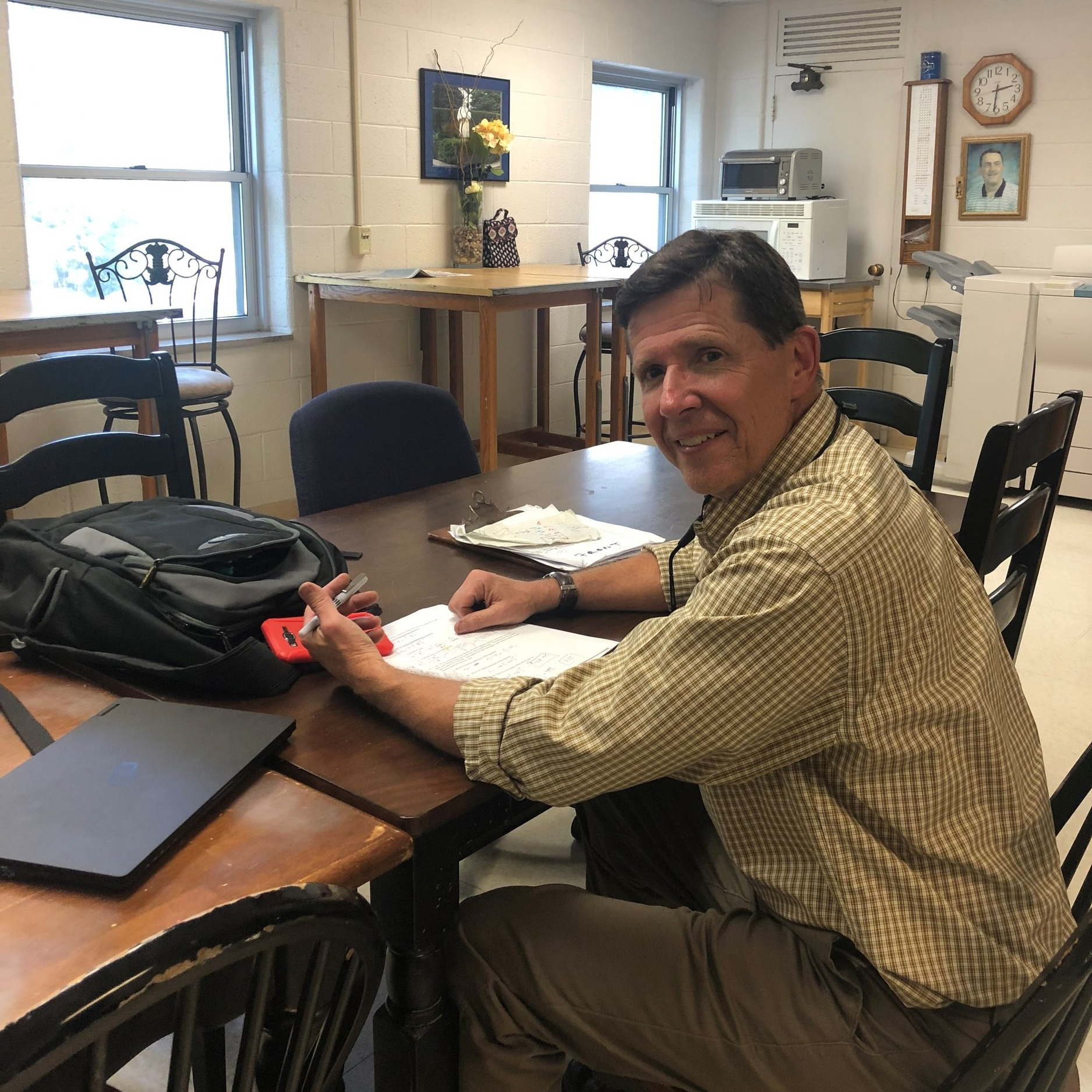 Mr. Prugh grading tests in the teacher's lounge  by Matt Jackson
