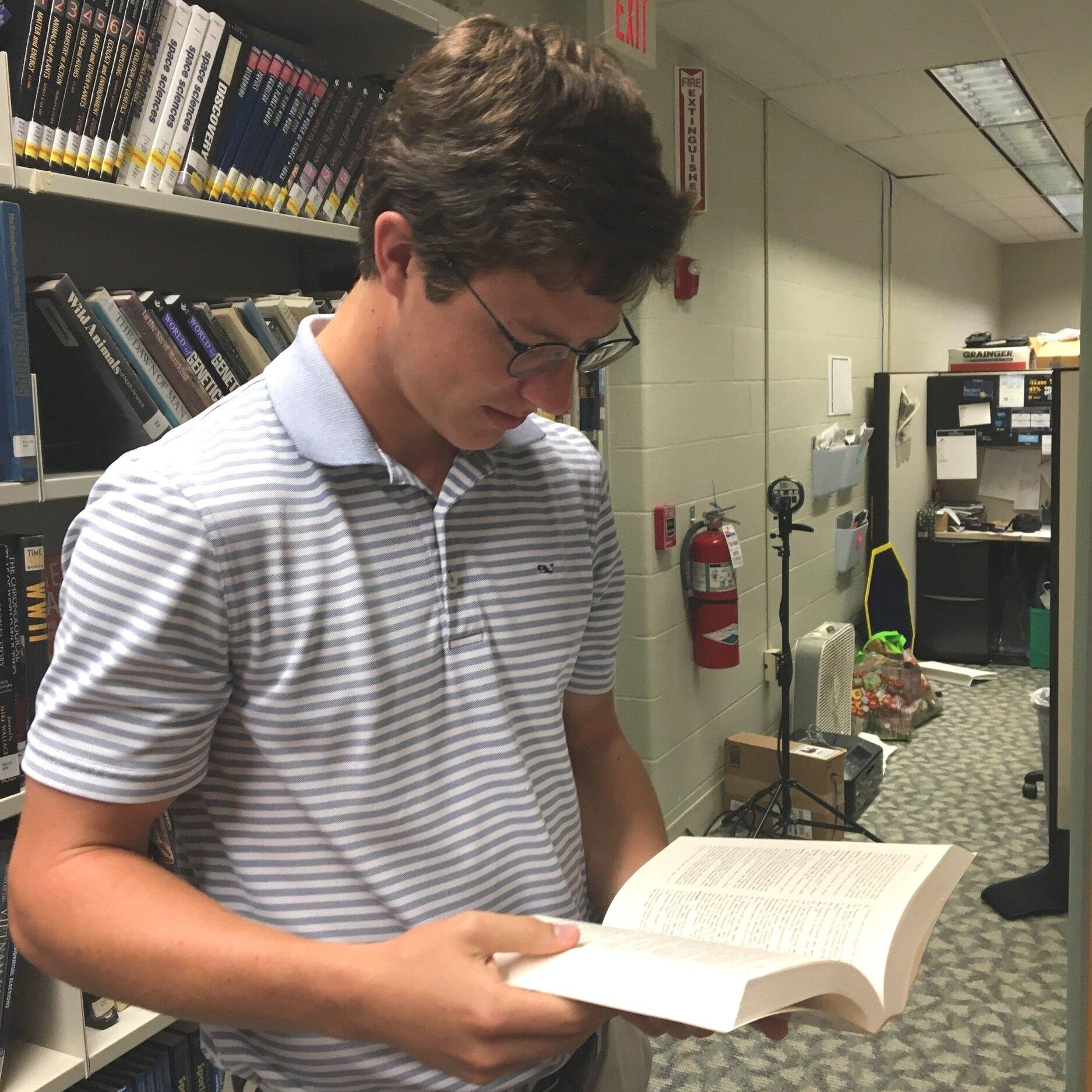 Senior captain Michael Currin deep in his studies  by Jack land