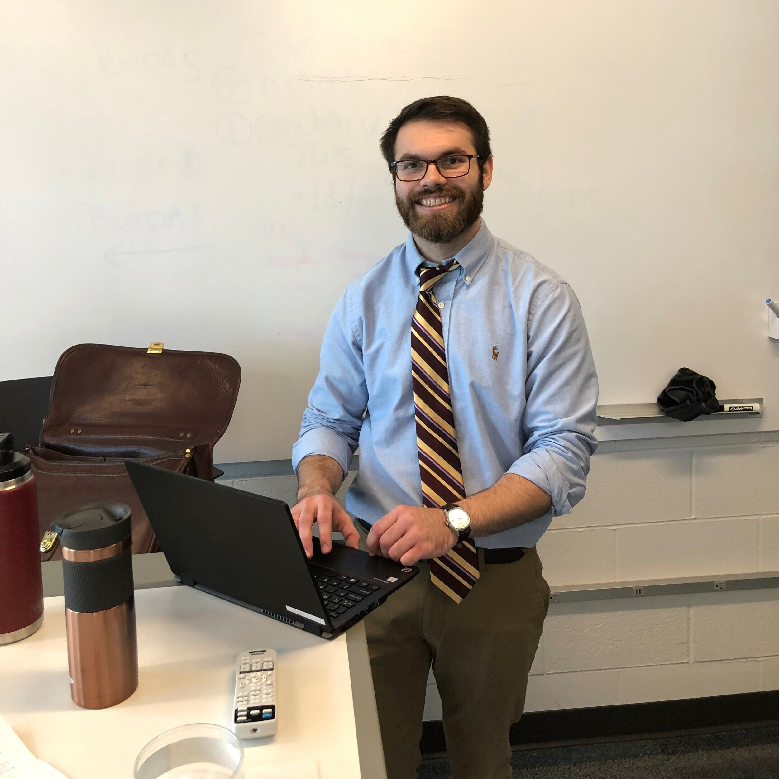 Mr. Battista at his desk  by Ethan Holley