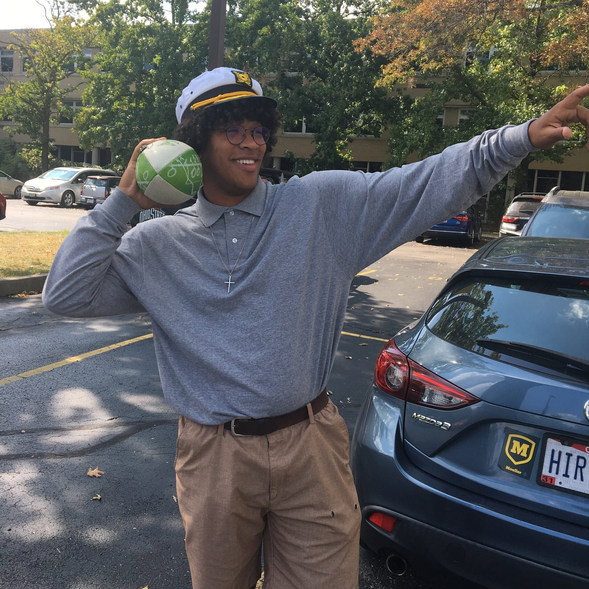 Senior captain Dobry Shaw showing of his rocket arm in the Moeller parking lot  by Jack Land