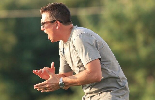 Coach Welker encourages the guys from the sidelines  by @MoeSoccer