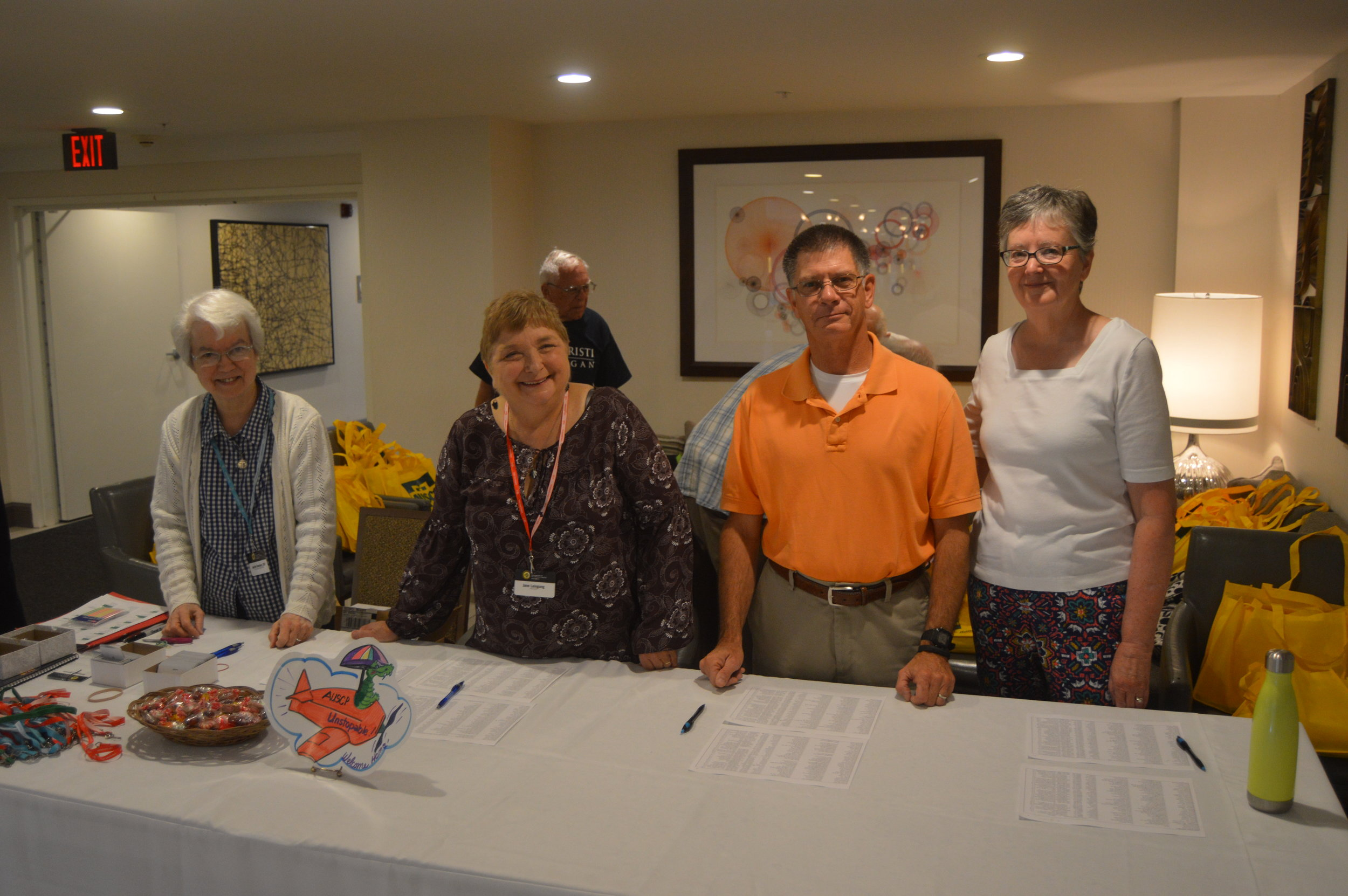 Sister Jackie Doepker, Jane Leingang, Scott Meierotto and Lesa Meierotto welcome arrivals at the registration table.