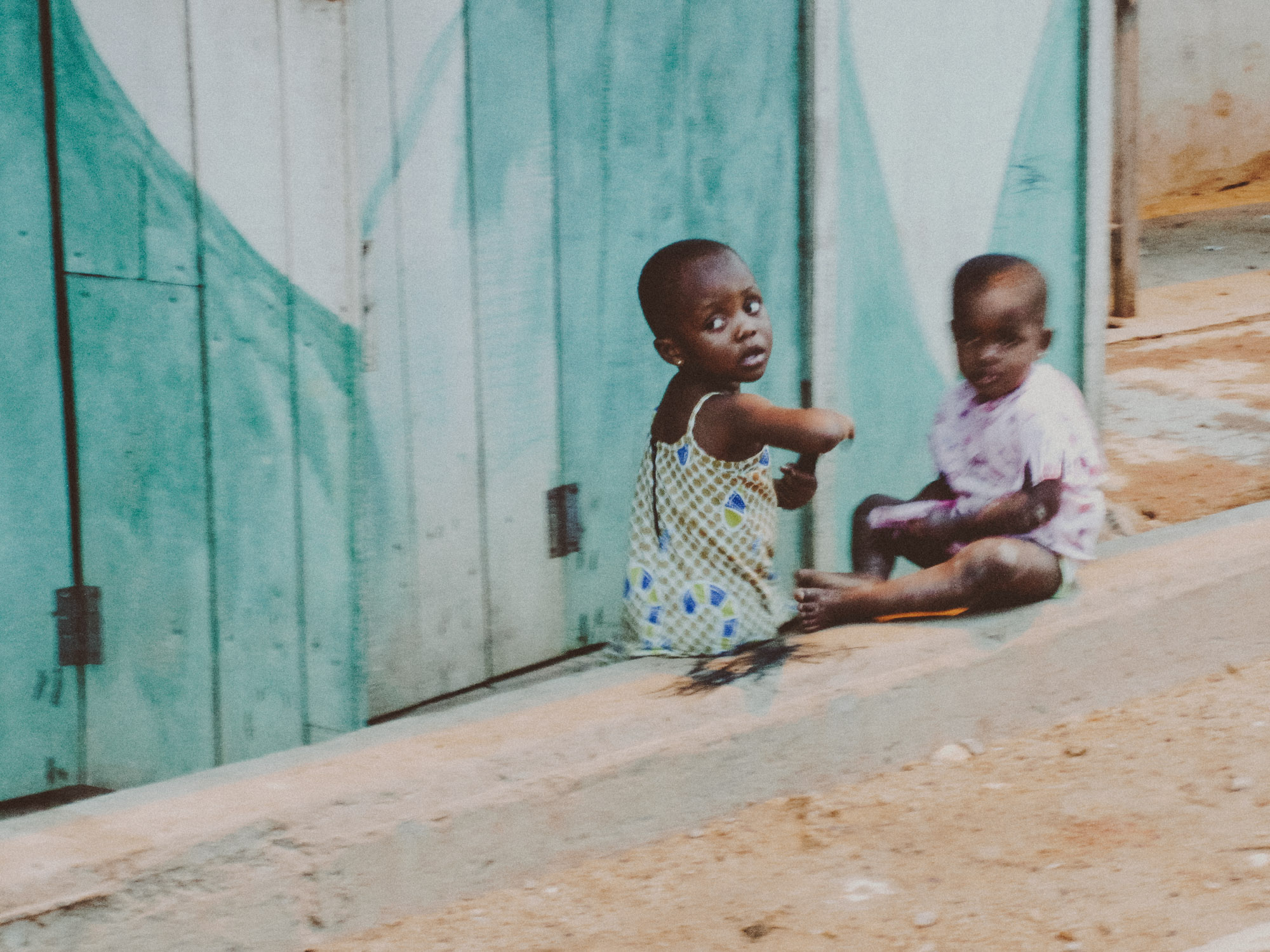 Children playing in the street in Cape Coast | Photo by Caroline Taft,  The Brazen Gourmand
