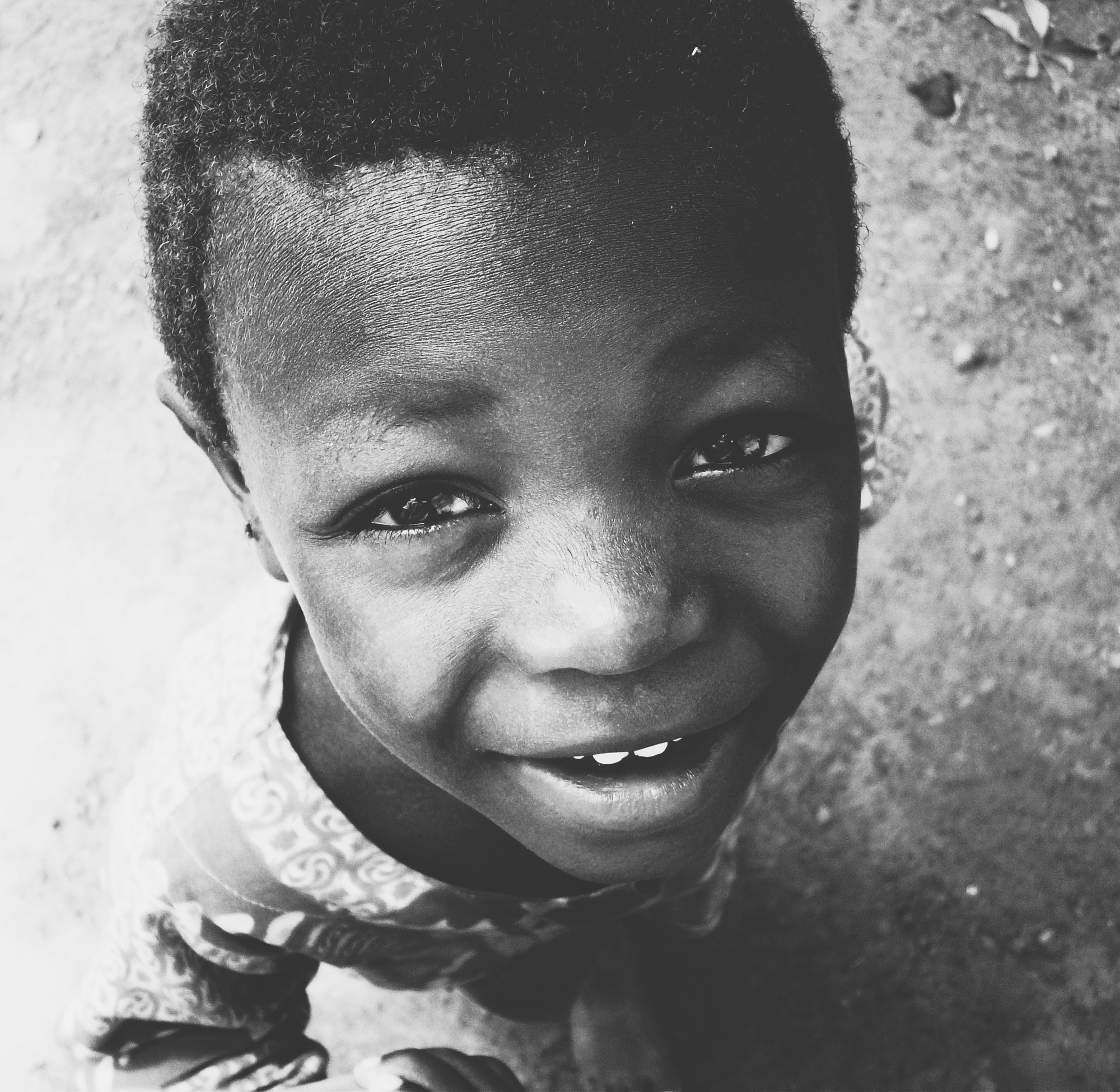 A smiling child in Cape Coast, Ghana | Photo by Caroline Taft,  The Brazen Gourmand