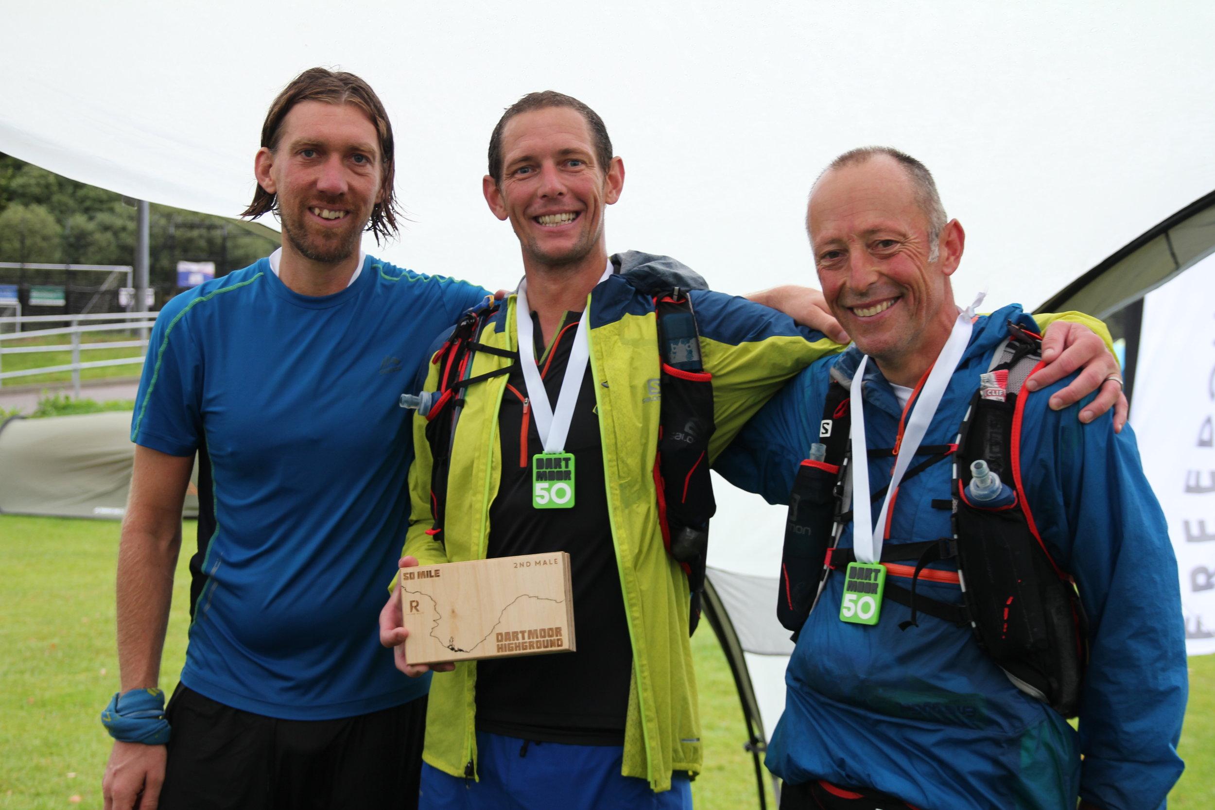 3 friends running on Dartmoor