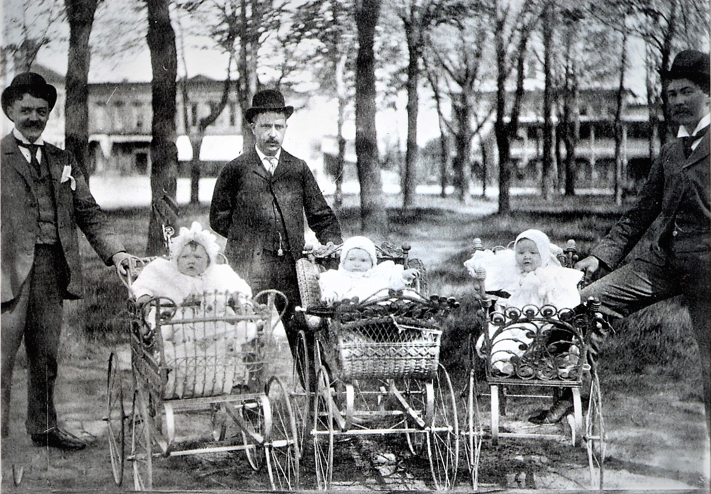F. E. Edwards, George F. High and Albert Oatman with children in Uptown Park in 1898