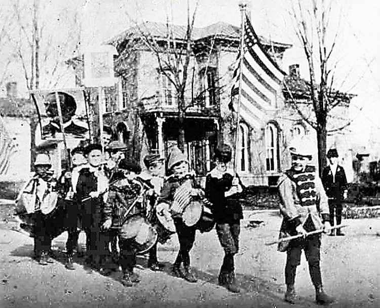 In this picture, nine little boys parade around the square, holding a picture of William McKinley. As the year of 1896 started to come to a close, McKinley's 'Front Porch' campaign had been a huge success, bringing the voters to him in his nearby home of Canton, Ohio.     With only 585 people voting in the village of Medina, McKinley won Medina with 441 of the votes being for him.