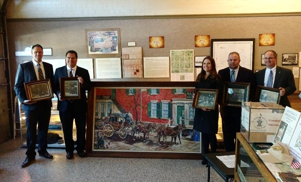 Huntington Bank representatives (from left) Steve VanDette, Medina branch business manager; Ron Paydo, Medina branch community president; Carrie Russell, Medina branch community manager; Kevin Rych, Medina branch business banker, Ron Paydo, and Dan Miksch, client advisor, presented a number of historical photos and a painting from the Old Phoenix Bank collection to the Medina Town Hall and Engine House Museum Oct. 18, 2017.