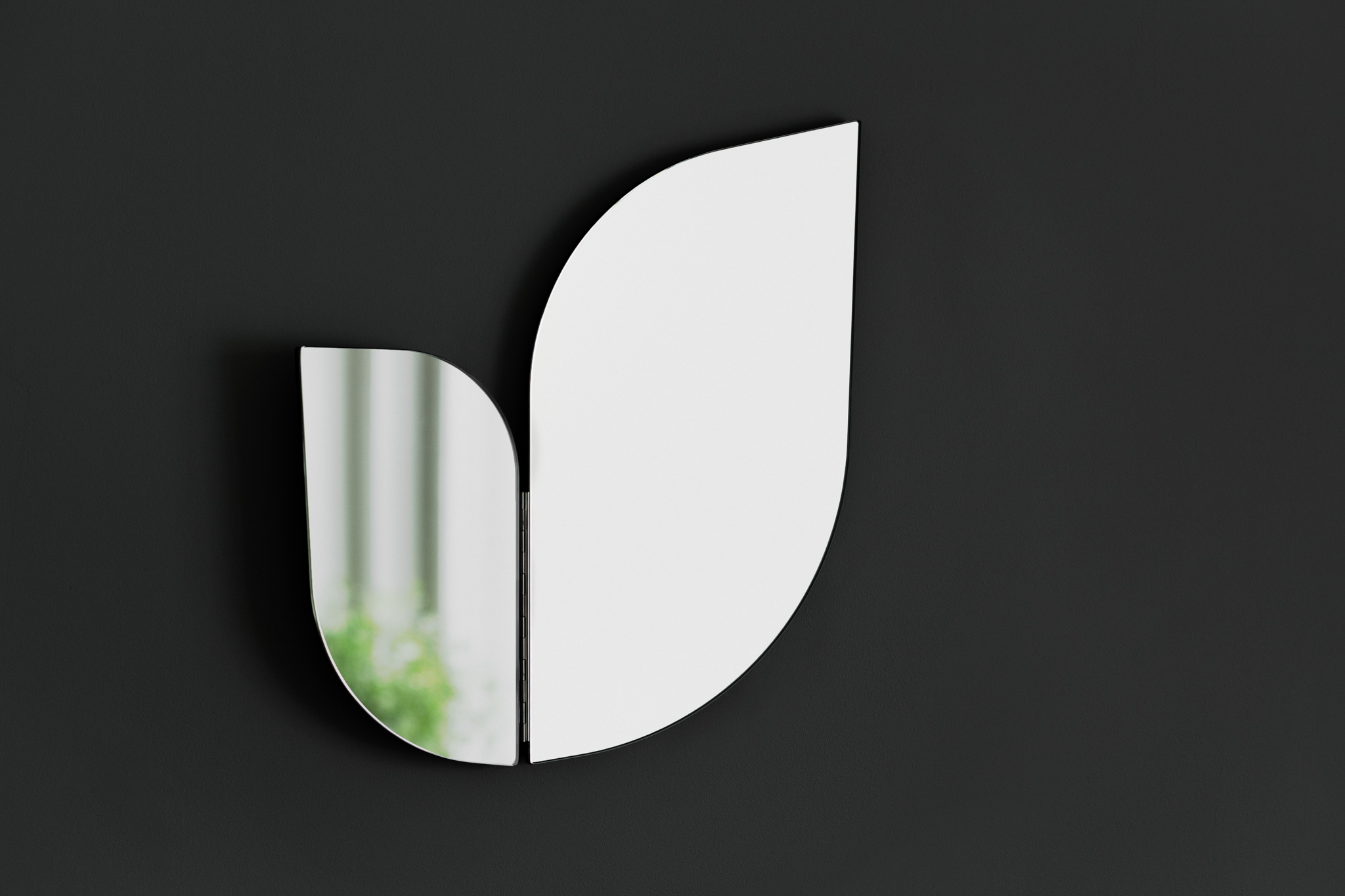 Perho mirror, optiwhite, 2017  Think touch of the wings of birds or sensitivity of flying butterfly. The fragility of these two creatures have inspired Katriina to compose these two part mirrors. The hinges between the mirror panels allow the smaller panel to be moved. It gives possibility to investigate and reflect the surroundings. You are not captured in one view only. Perho mirror comes in two sizes and several colours.  For Klong.  Buy here.