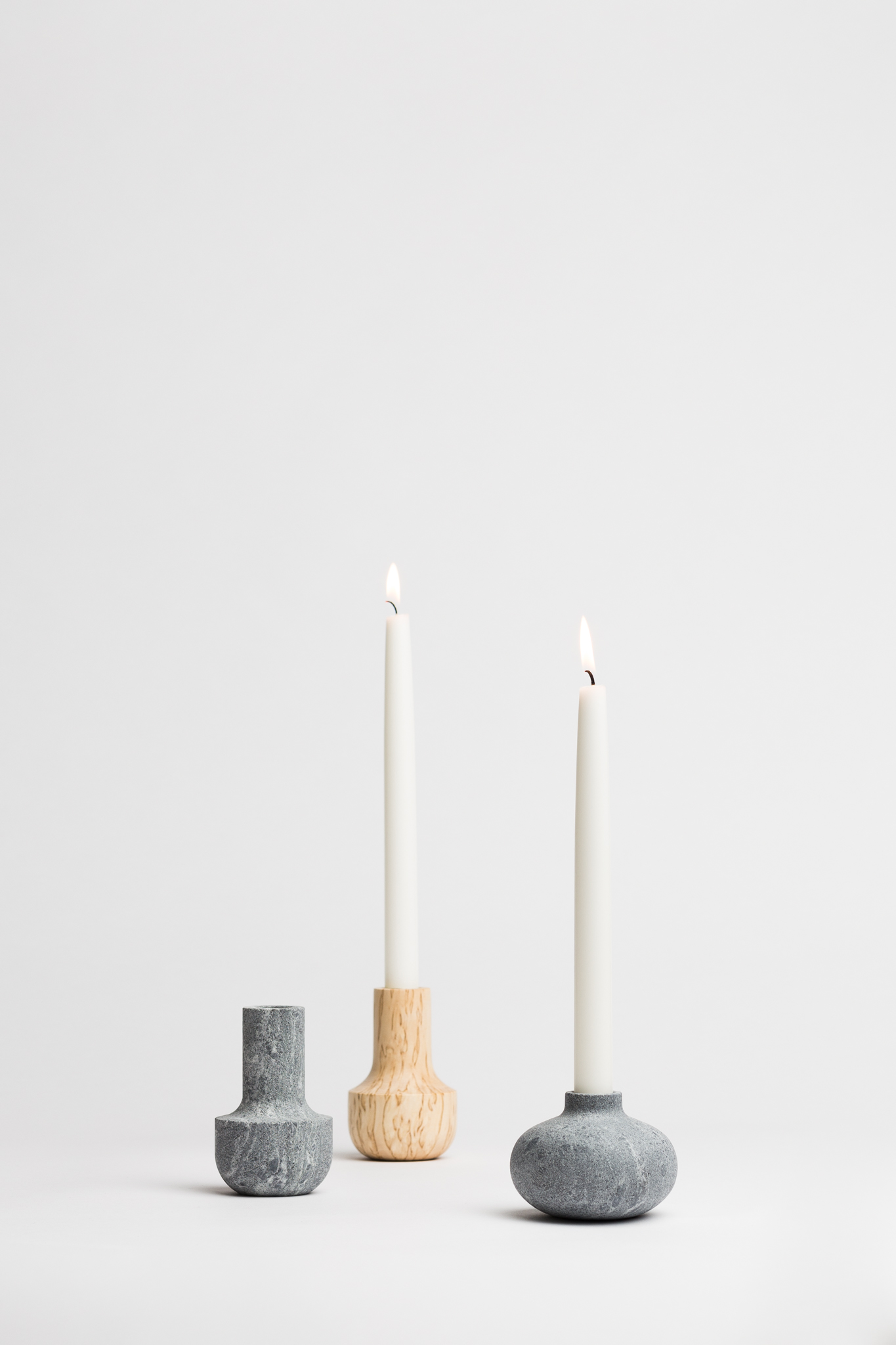 "Alku&Aina candleholders, 2017  Alku & Aina candle holders are made from Carelian Soapstone and Finnish Curly birch. Both these materials occur naturally where Katriina's roots are, in Carelia, Eastern Finland. The round Alku (meaning ""beginning"") is the base and the beginning of the tale. It reflects how and where the story begins. The taller one, Aina (meaning ""always"") reminds that wherever you are, your roots follow and support you and can be the rock to lean on. Always let the flame shine bright!  For Katriina Nuutinen Studio.  Buy here."