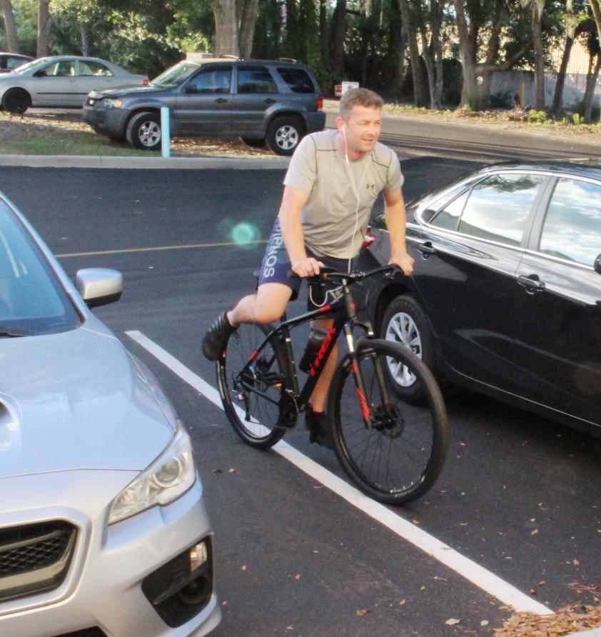 Matt O biking to the gym.