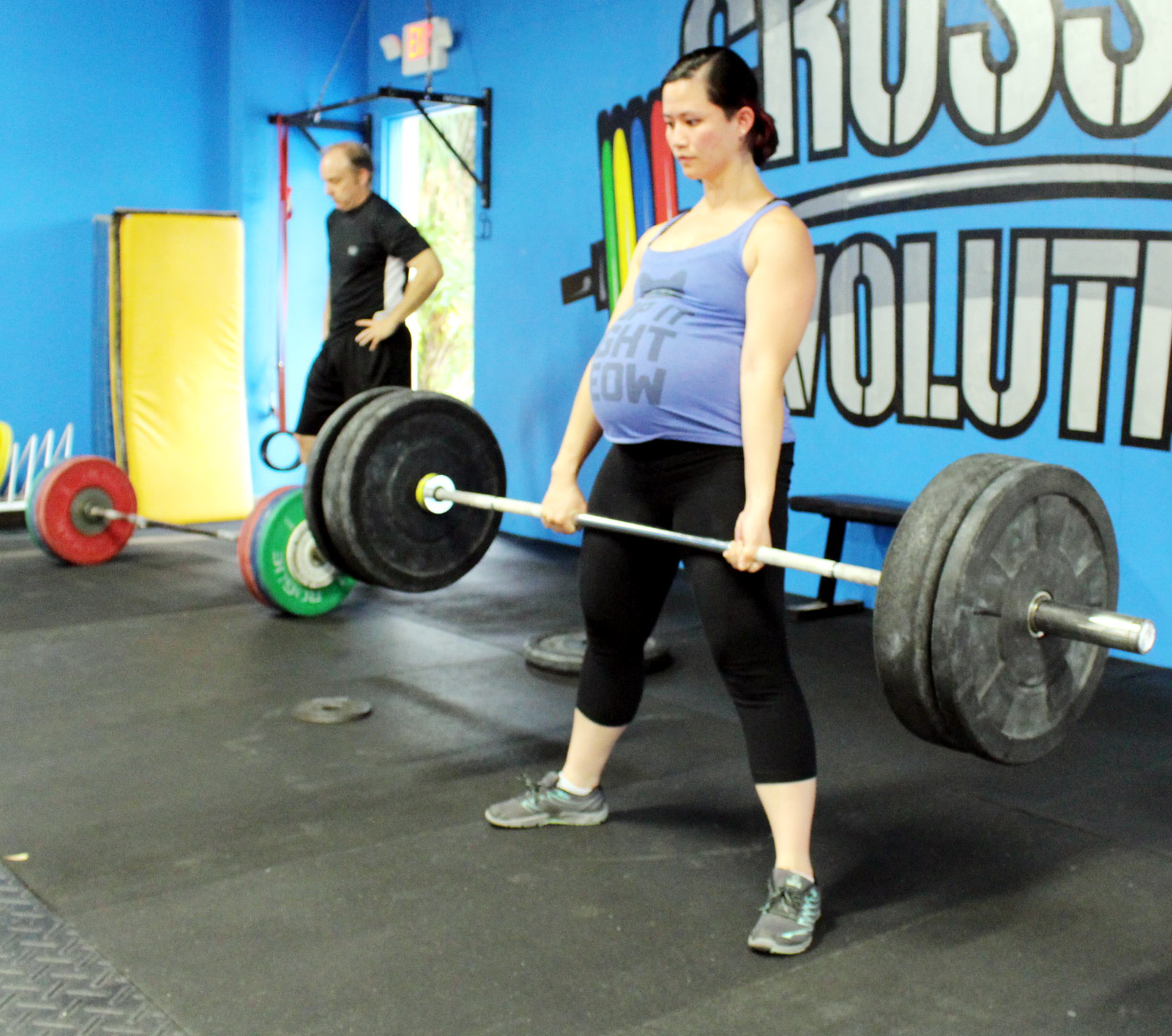 Anne deadlifting only a couple days before their family grew by 50% with an addition of a baby boy! Congratulations to you and Jason!