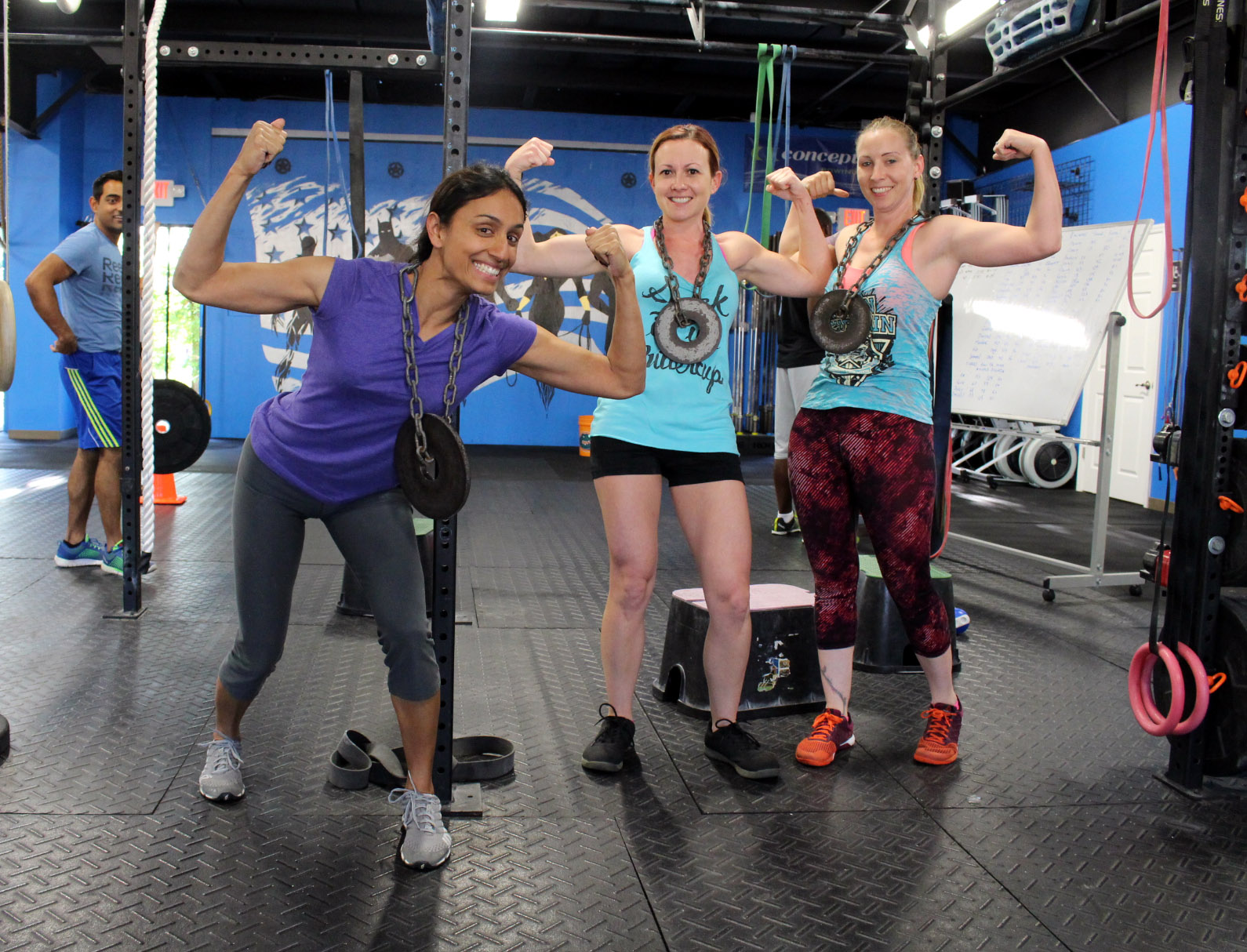 Tejal, Mary & Devon in between sets of Weighted Pull-ups.