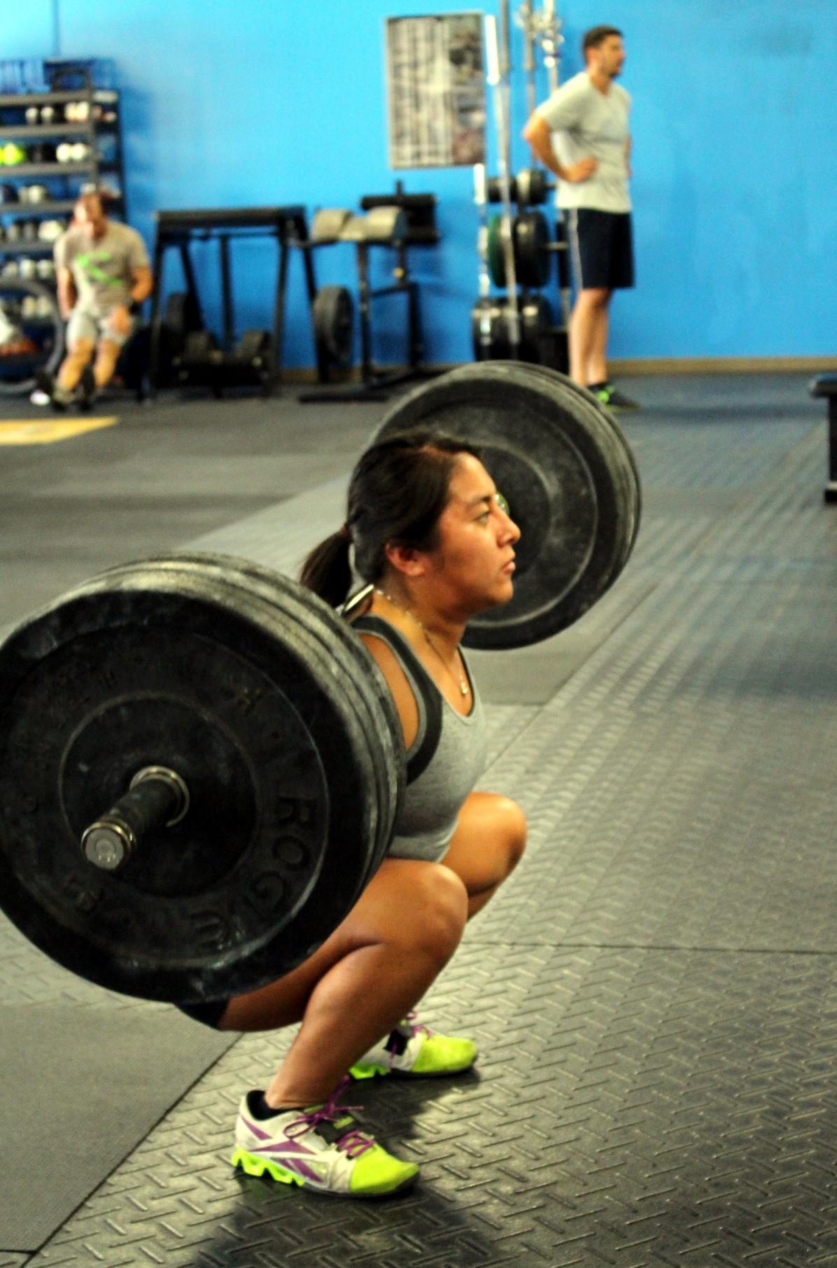 Joy back squatting