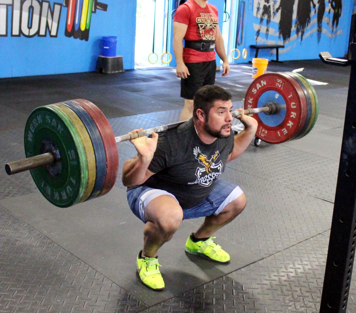 Nestor casually back squatting