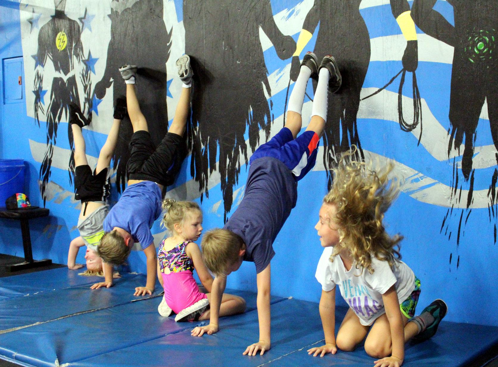 Kids practicing Handstands & Headstands