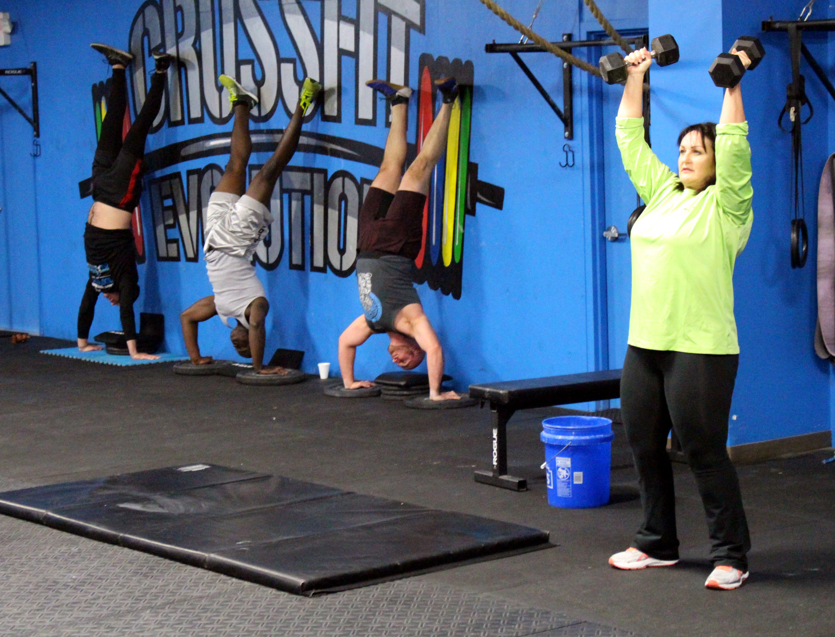 Shoulder Presses are a great beginner exercise instead of Handstand Push-ups
