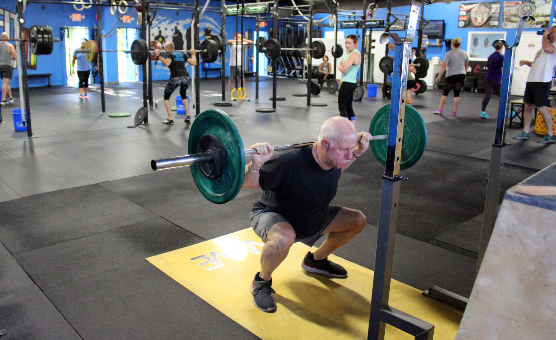 Gene back squatting