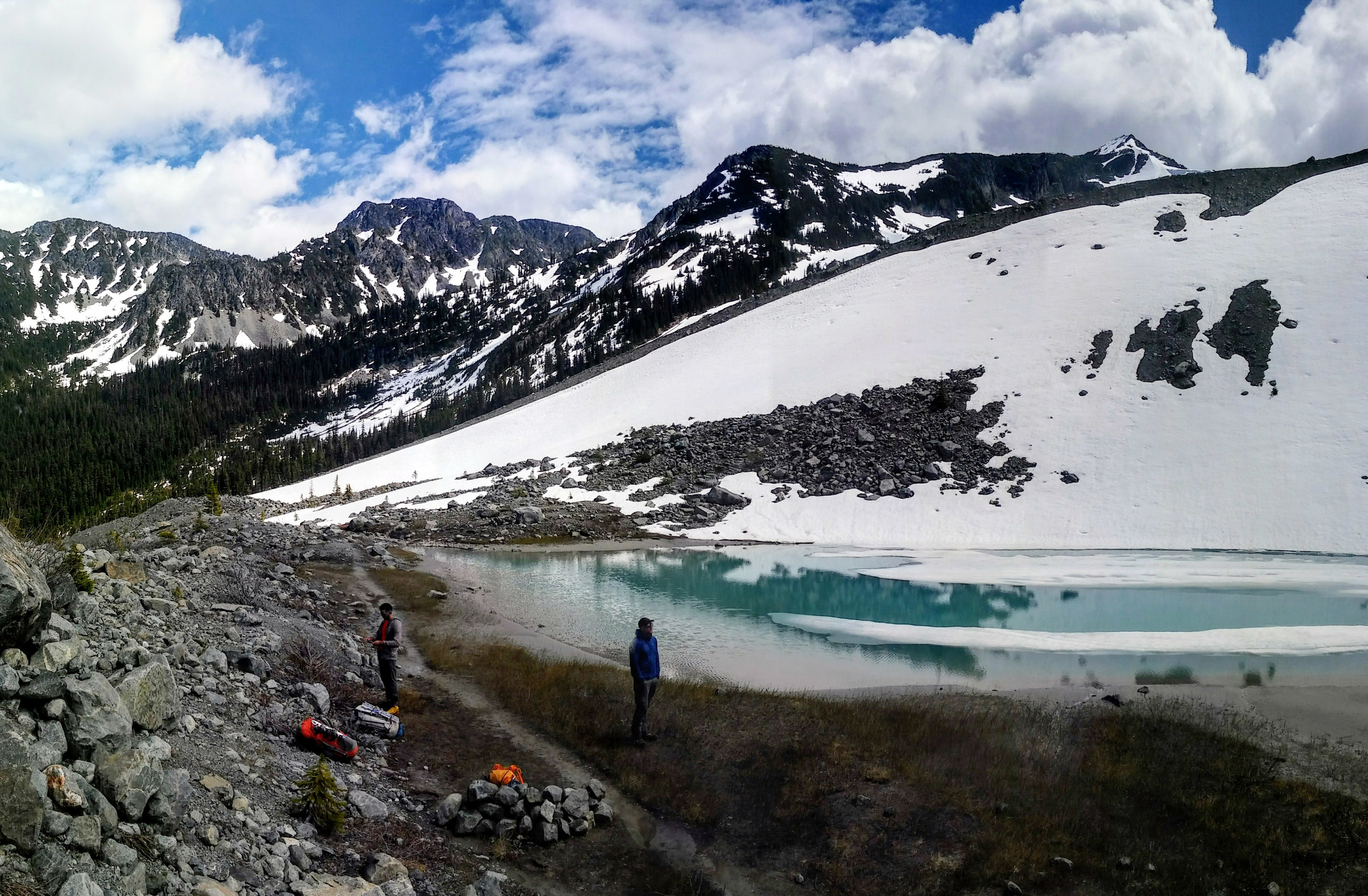 Camping by a glacial lake before climbing the next day. Matt is assessing the ascent.