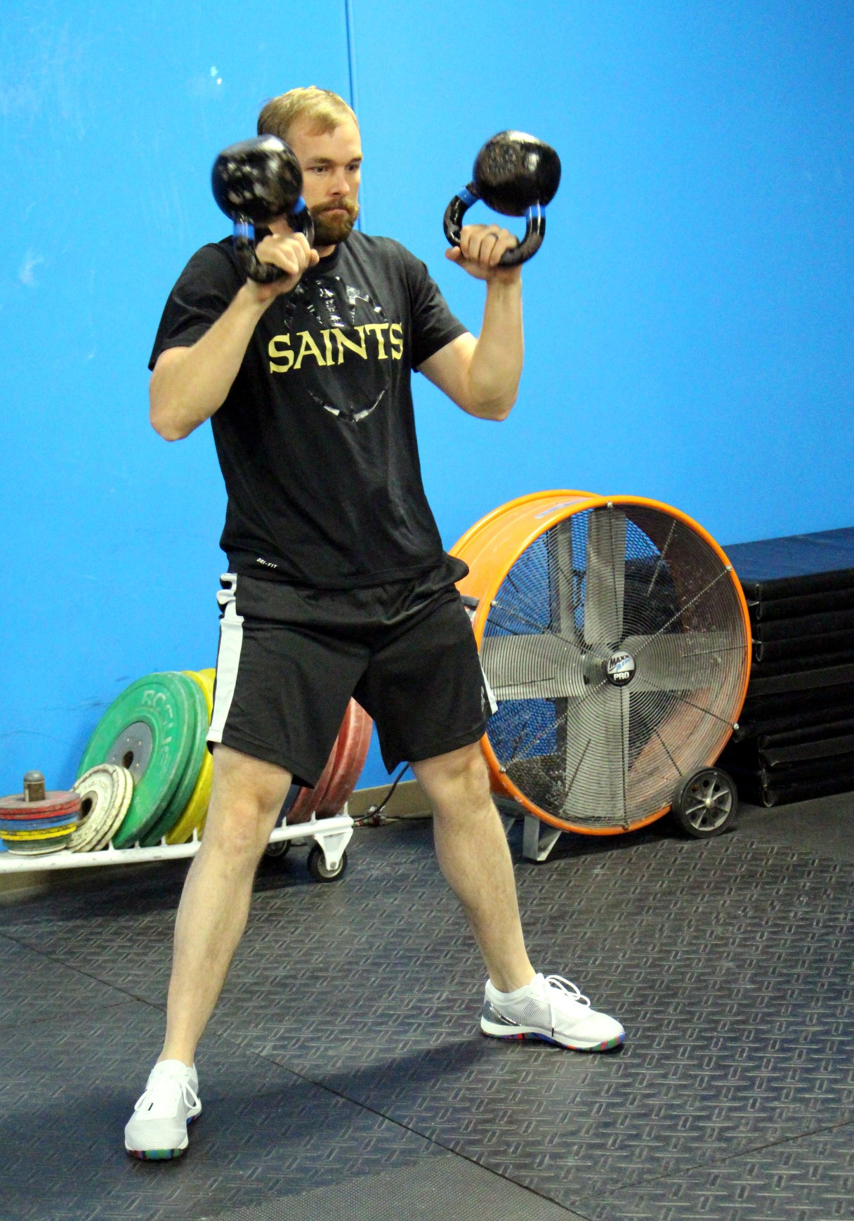 Mike doing a Double Kettlebell Clean.
