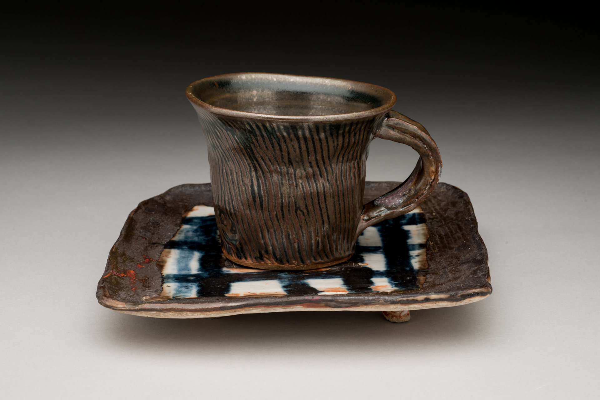 "Brown  textured cup and Blue and White checkered plate..-cup-3""Hx6""L., plate appx.7.5""square, 2016"