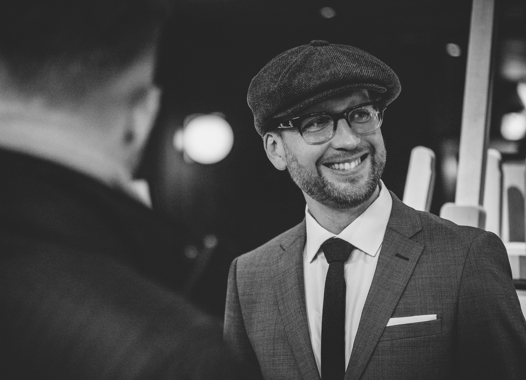 Jay McLaughlin Grey Suit Pocket Square Tie Newsboy Cap Photographer Olympus PEN Ambassador