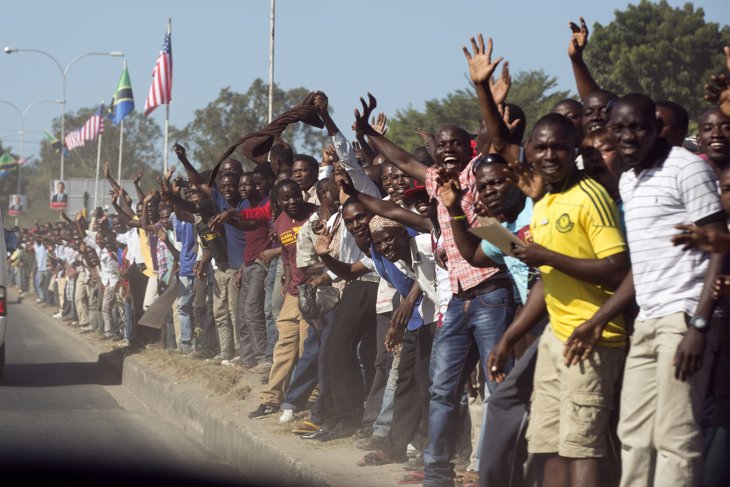People line the street as President Barack Obama's motorcade travels through Dar es Salaam, Tanzania - 2013.