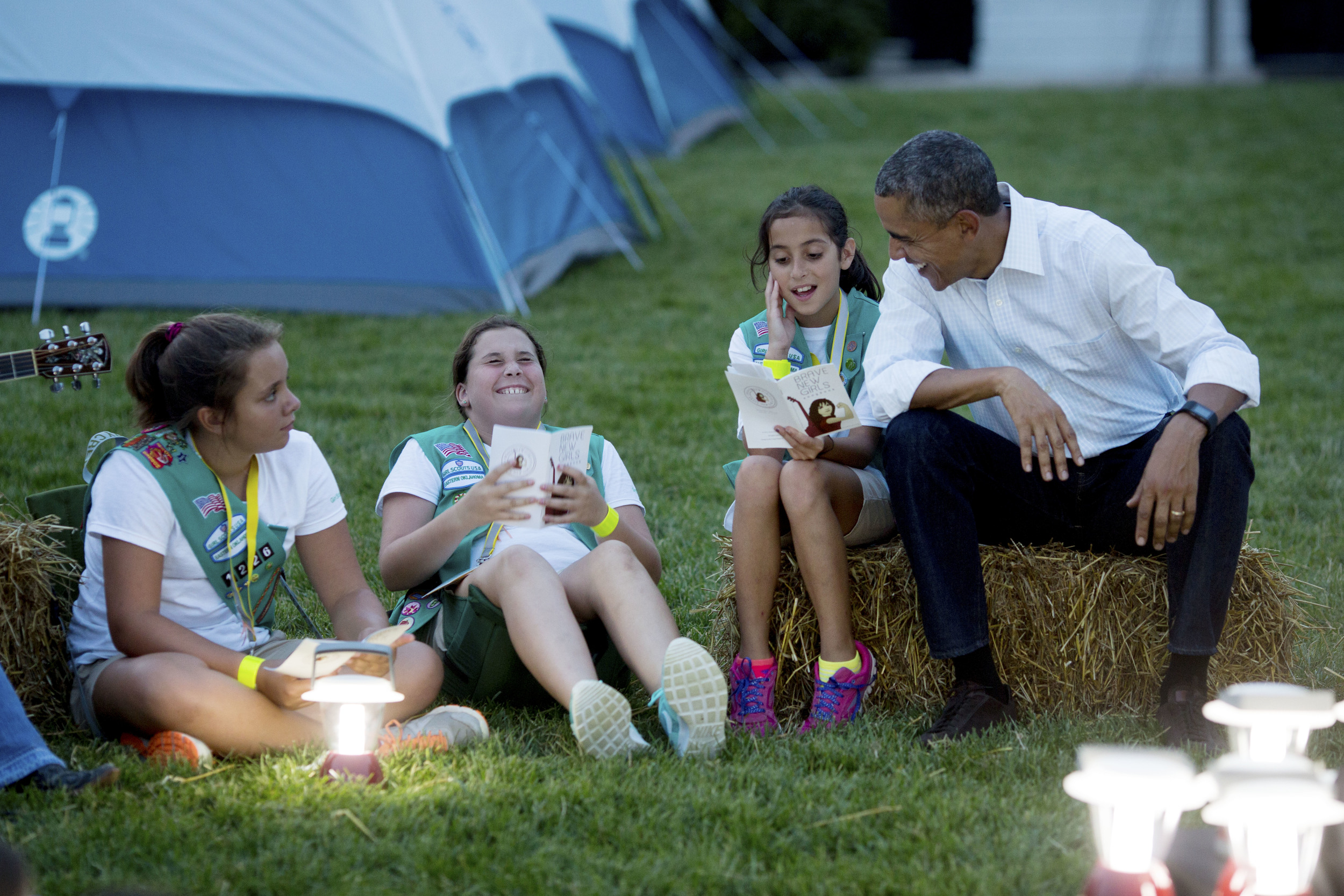 "President Barack Obama and First Lady Michelle Obama sing songs with Girl Scouts during the White House Campout, as part of ""Let's Move! Outside"" on the South Lawn - 2015."