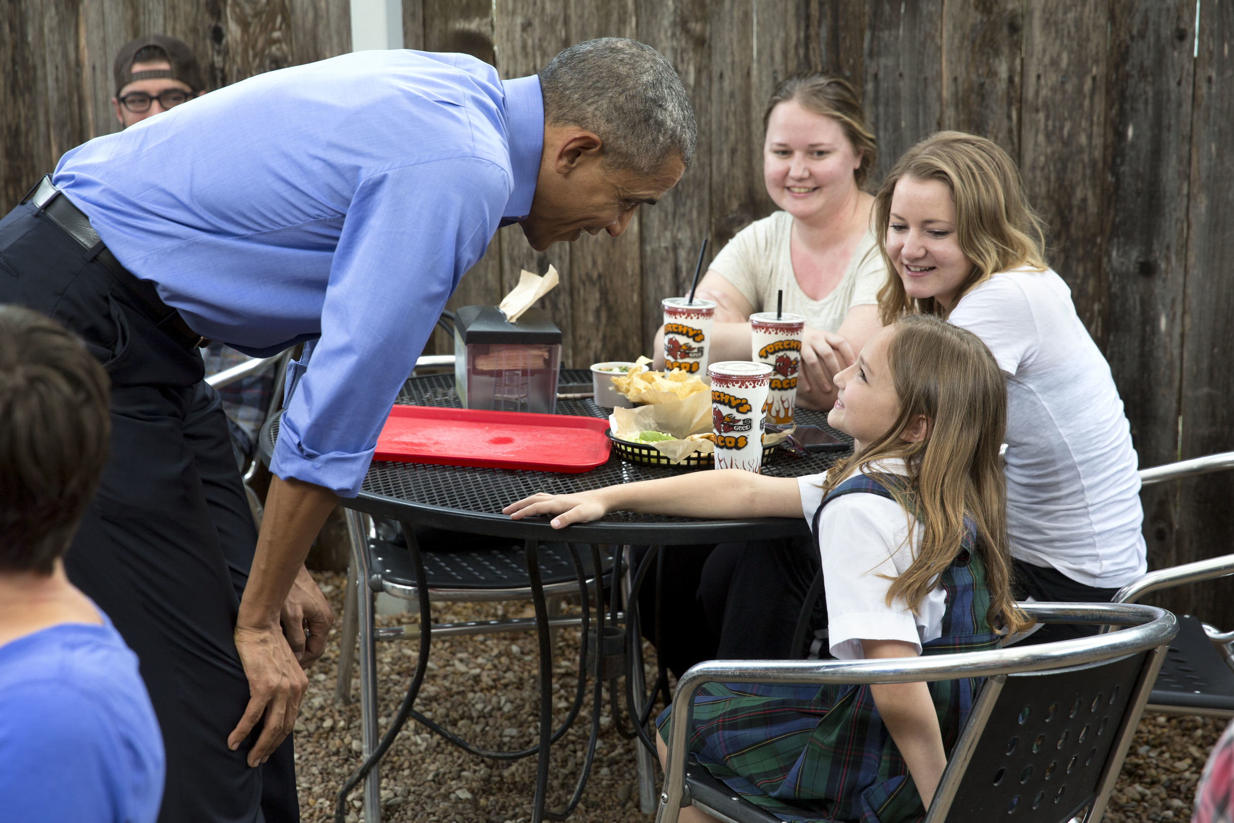 President Barack Obama talks to a young diner at Torchy's Tacos in Austin, Tx. - 2016