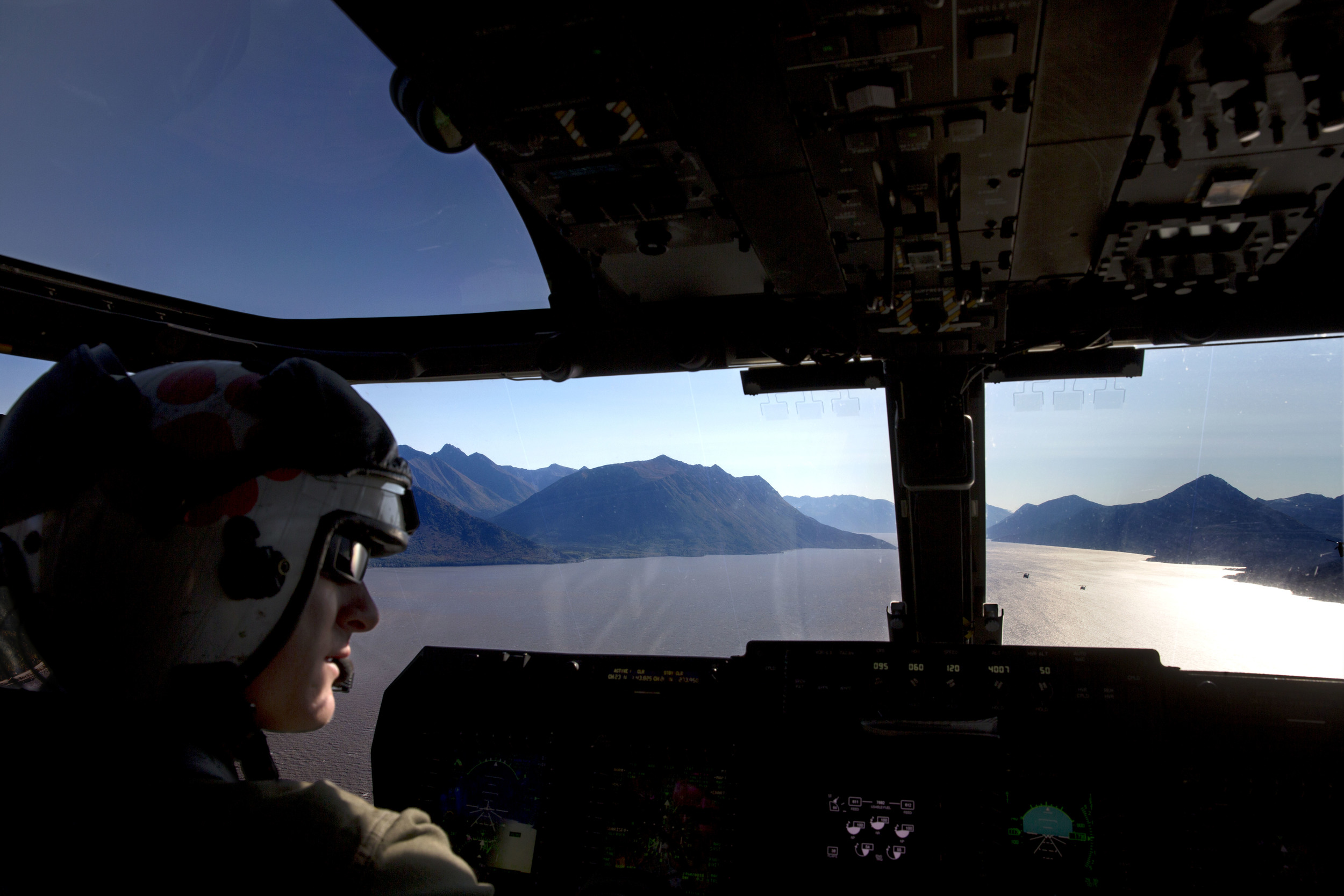 The view from the cockpit of Nighthawk 4 Osprey helicopter flying to Seward, Alaska. Marine One and Nighthawk 2 in the lead.