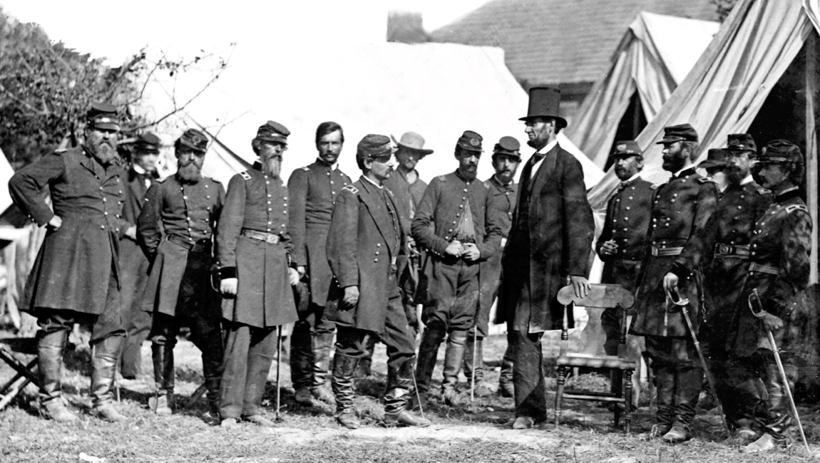 President Lincoln, shown here with his generals after the battle of Antitetam in 1862. Antietam, located in Sharpsburg, Maryland was the bloodiest single-day battle in American history with over 23,000 Confederate and Union soldiers casualties. Most of the generals pictured; Burnside, Hooker, McDowell, McLellan, and Pope would be eventually fired due to their inability to commit to a winning strategy which required an all-in approach. While the battle technically concluded in a draw, General Lee accomplished this with half of the troops than of the Union Army and use of a more aggressive and 'playing to win' strategy.
