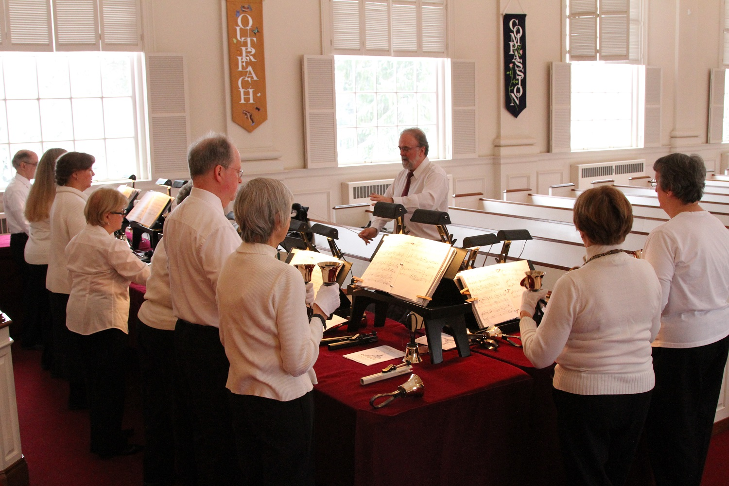 The Bell Choir prepares for worship.