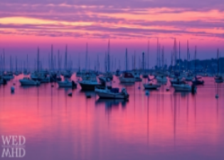 A rosy sunrise over the harbor