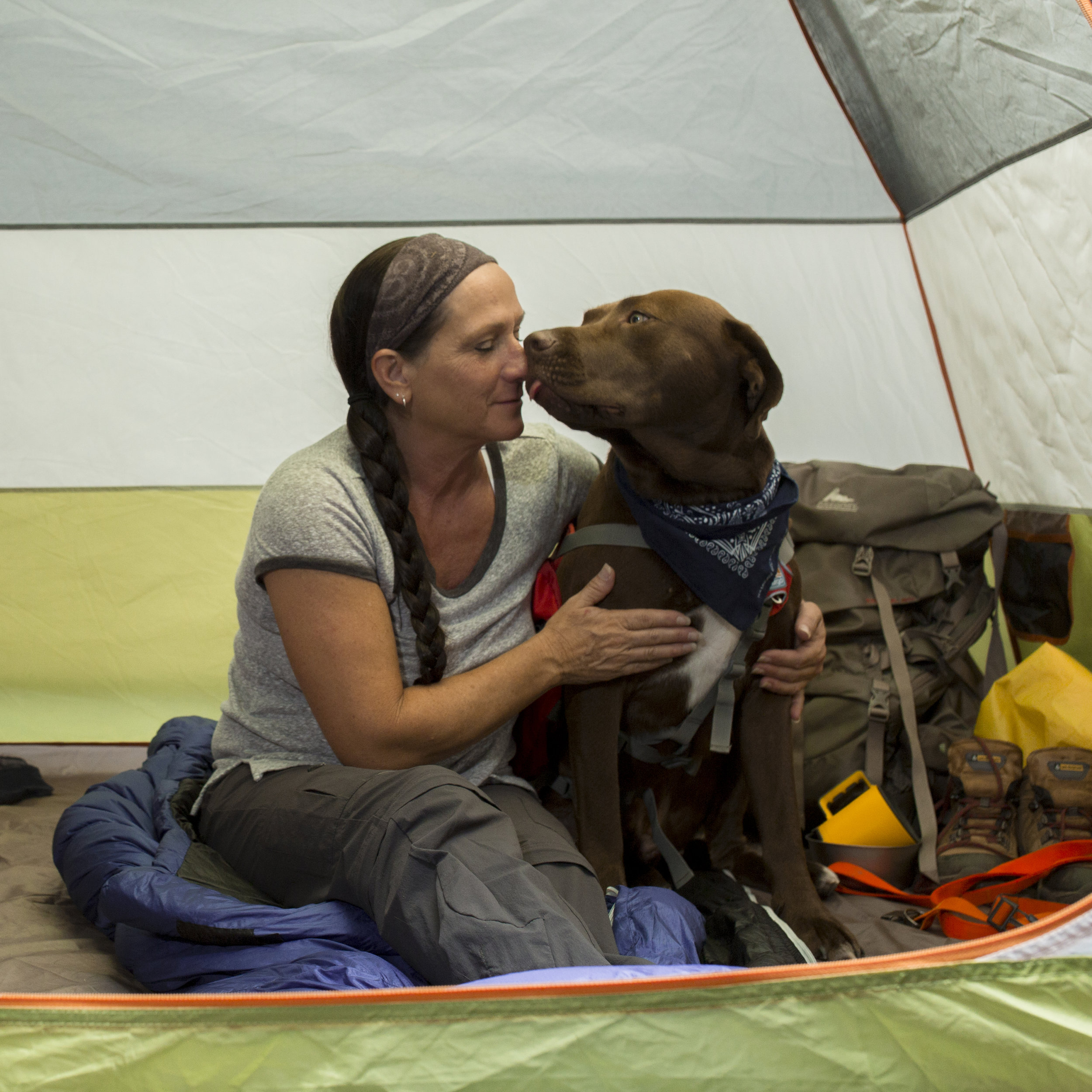 Woman and Dog Camping