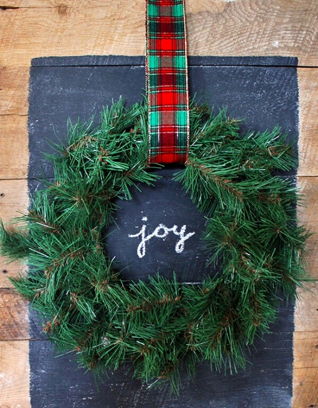 a reclaimed wood chalkboard with a holiday message