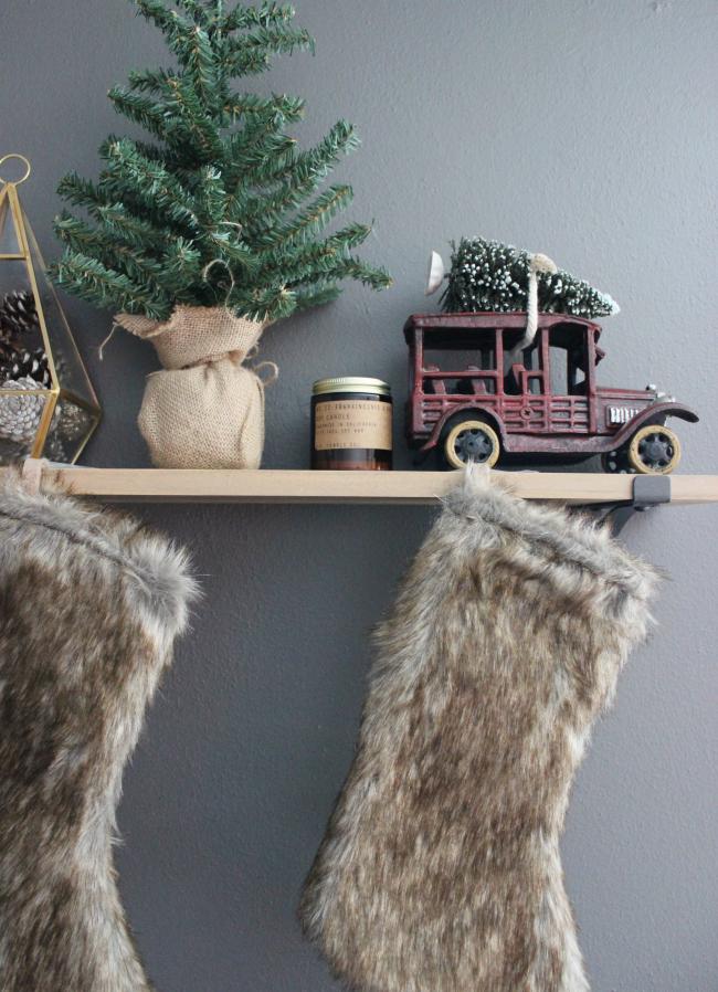 faux fur stockings, metallic pinecones & a tiny bottlebrush tree tied to a vintage car