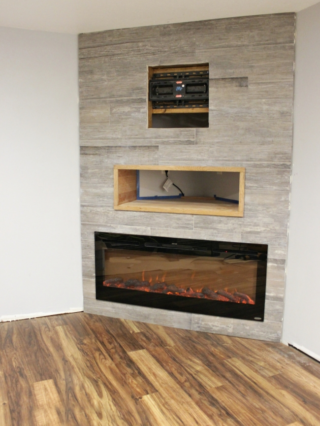 electric fireplace & wood look tile | rustic modern basement