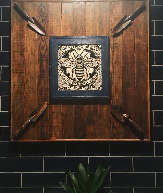 Reclaimed wood sign at Tupelo Honey Cafe in Denver, Colorado