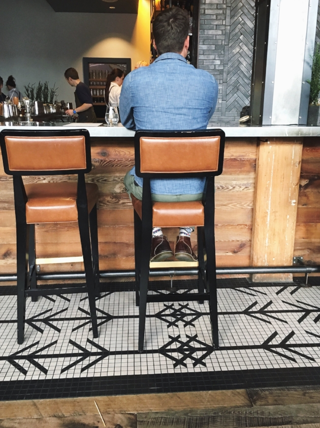 That tile pattern and tan leather bar stools..!