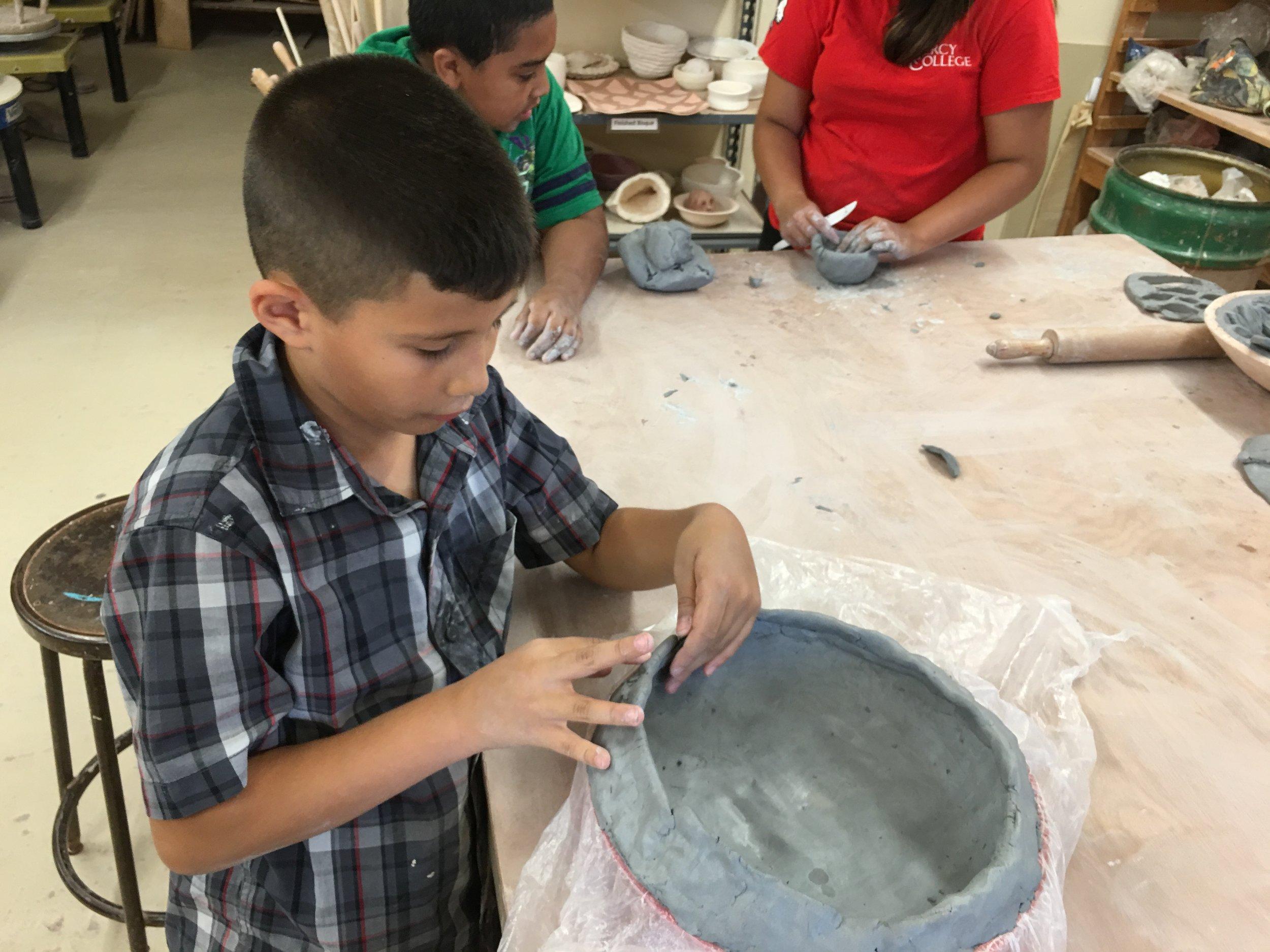 clay-art-center-kids-bring-change_28026436610_o.jpg