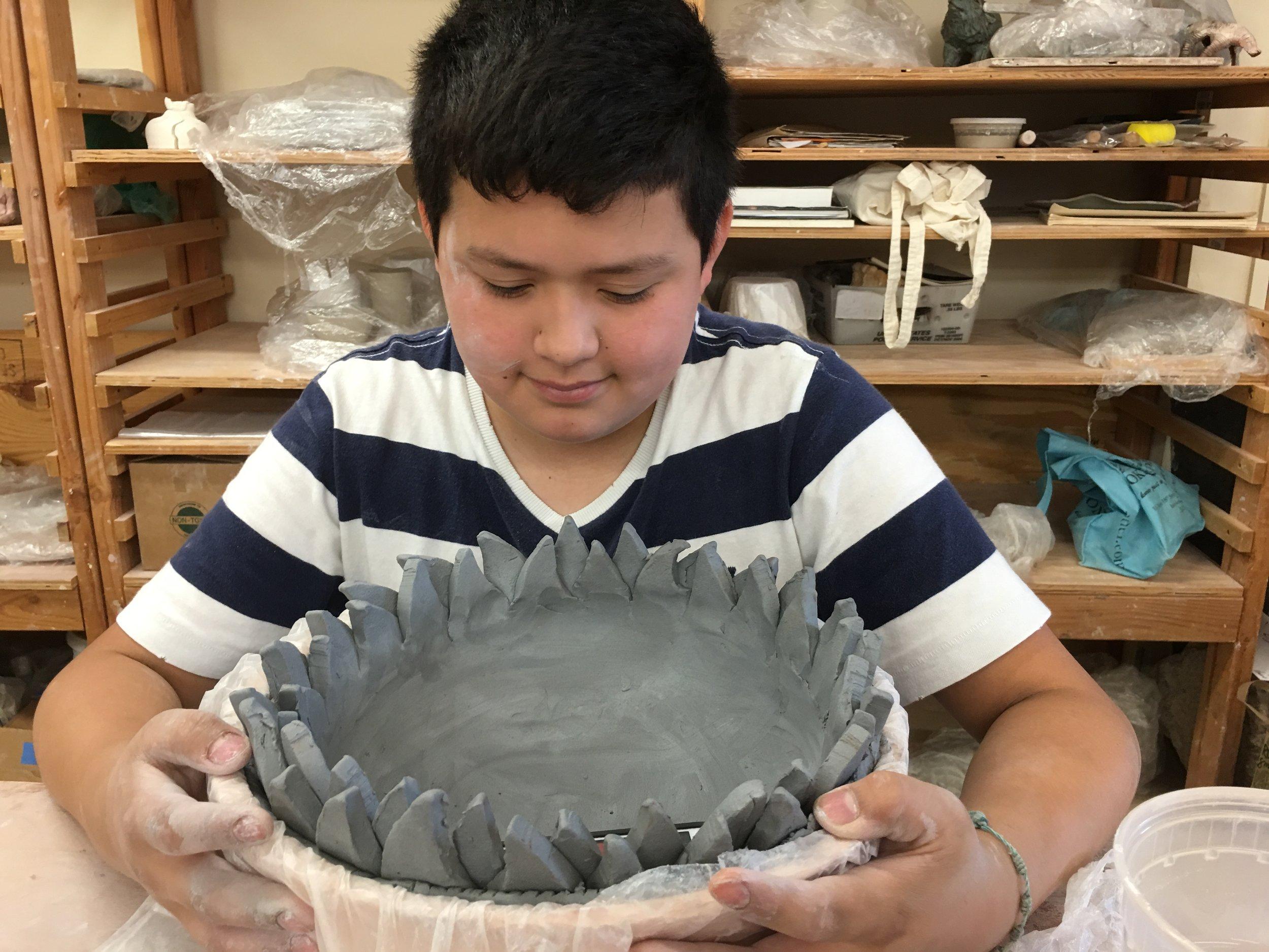 clay-art-center-kids-bring-change_28026439230_o.jpg