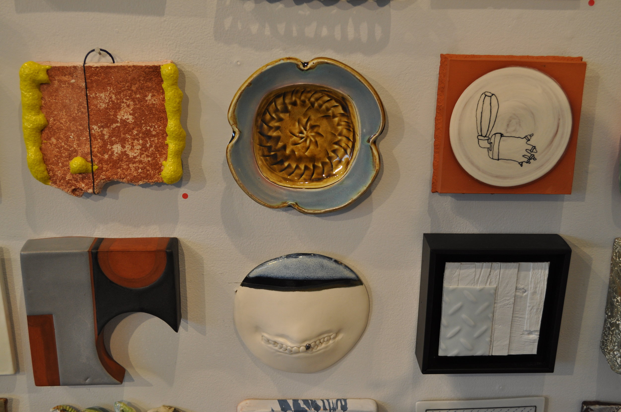 1 . Max Seinfeld,  Composition Study  SOLD  2. Gertrude Graham Smith, Squared Plate/Tile  $42  3.  Matthew Wilt, Hearing Machine  $150  4. Logan Wall,  Wall Tile #3  SOLD  5. Ginny Waters,  Kissing The Lipless 1 (round & black )  $45  6.  Bryan Hopkins,  Tile 1  $95