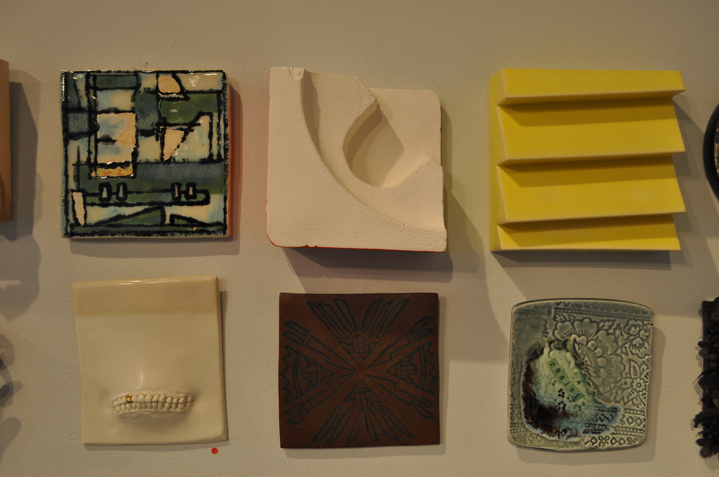 1.  Roni Cohen,  Homage To Mondrain 2  $38  2.  Elenor Wilson,  Construction Foam #3  $150  3.  Jim Lawton,  Yellow Lapstrake Tile 1  $145  4.  Ginny Waters,  Kissing The Lipless 4(square & cream)  (SOLD)  5.  Carol Long,  Arrows Pointing- Fighting Stops  $50  6.  Karen Ford,  Resist 1  $85