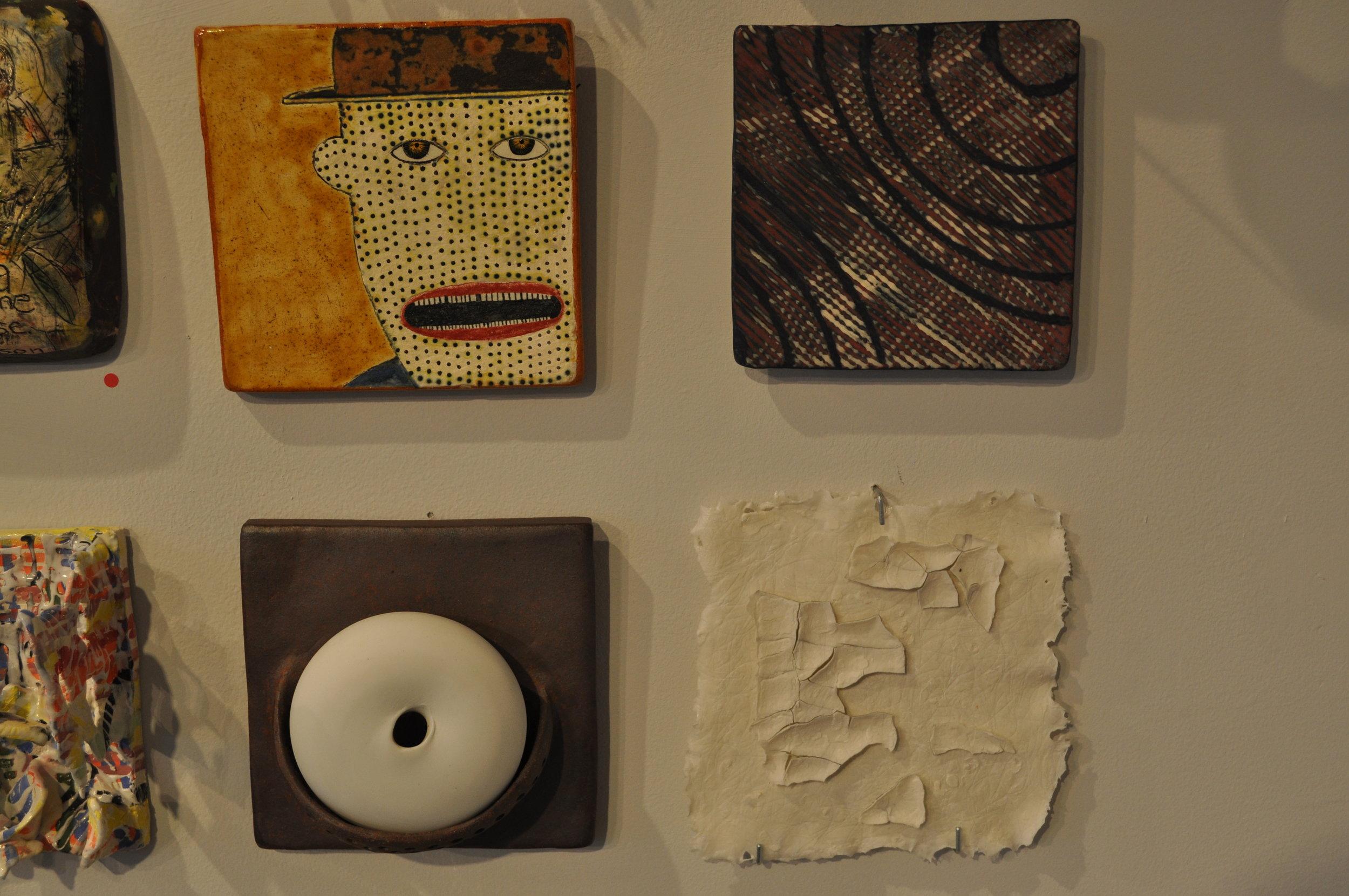 1.  Wesley Anderegg,  Tile #2  (SOLD)  2.  Lana Wilson,  Double Patterned Background  $90  3.  Deborah Lecce,  White Pod Tile- Vase  $120  4.  Clementine Porcelain,  Paper 6x6 (Tracy Shell)  $80
