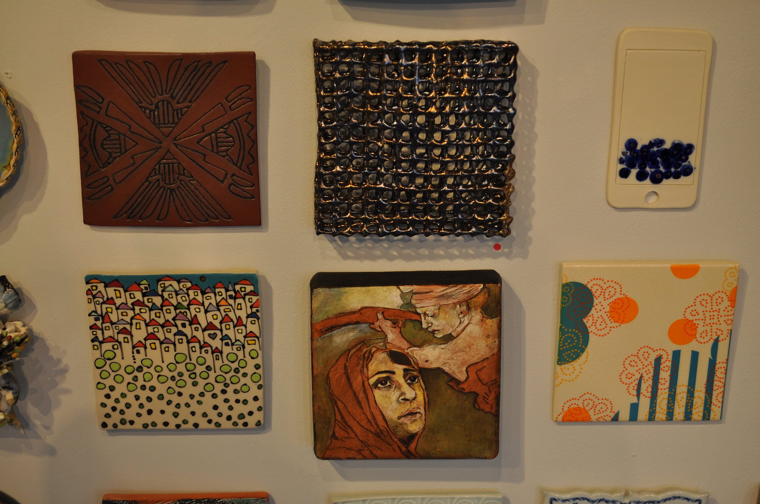 1.  Carol Long,  Arrows Pointing- Fighting Stops  $50  2.  Jackie Welsh,  Untitled 2  (SOLD) 3.  Adam Chau,  Txt Me  $60  4. Emily Free Wilson,  Community 1  $100  5 . Melisa Cadell,  I Will Accept   $298  6.  Meredith Host,  Dot Dot Doily Tile  $60