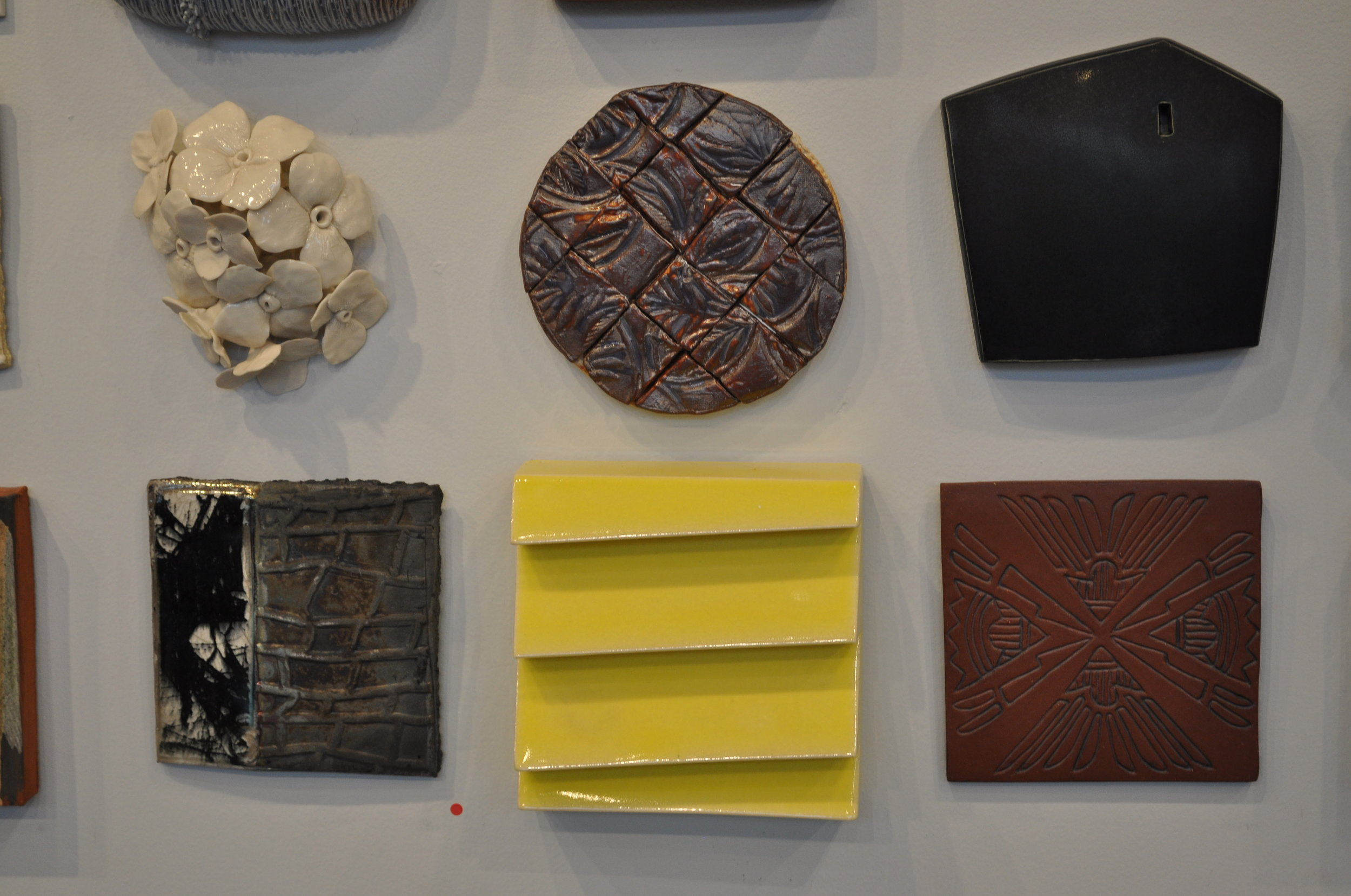 1.  Christina Pitsch,  Pansy 2  $325  2.  Myra Bowie,  Squares in the circle    $40  3.  Jill Oberman,  Home $175  4. Helayne Friedland,  Branches tile 2  (SOLD) 5.  Jim Lawton,  Yellow Lapstrake Tile 2  (SOLD) 6.  Carol Long,  Arrows Pointing- Fighting Stops  $50