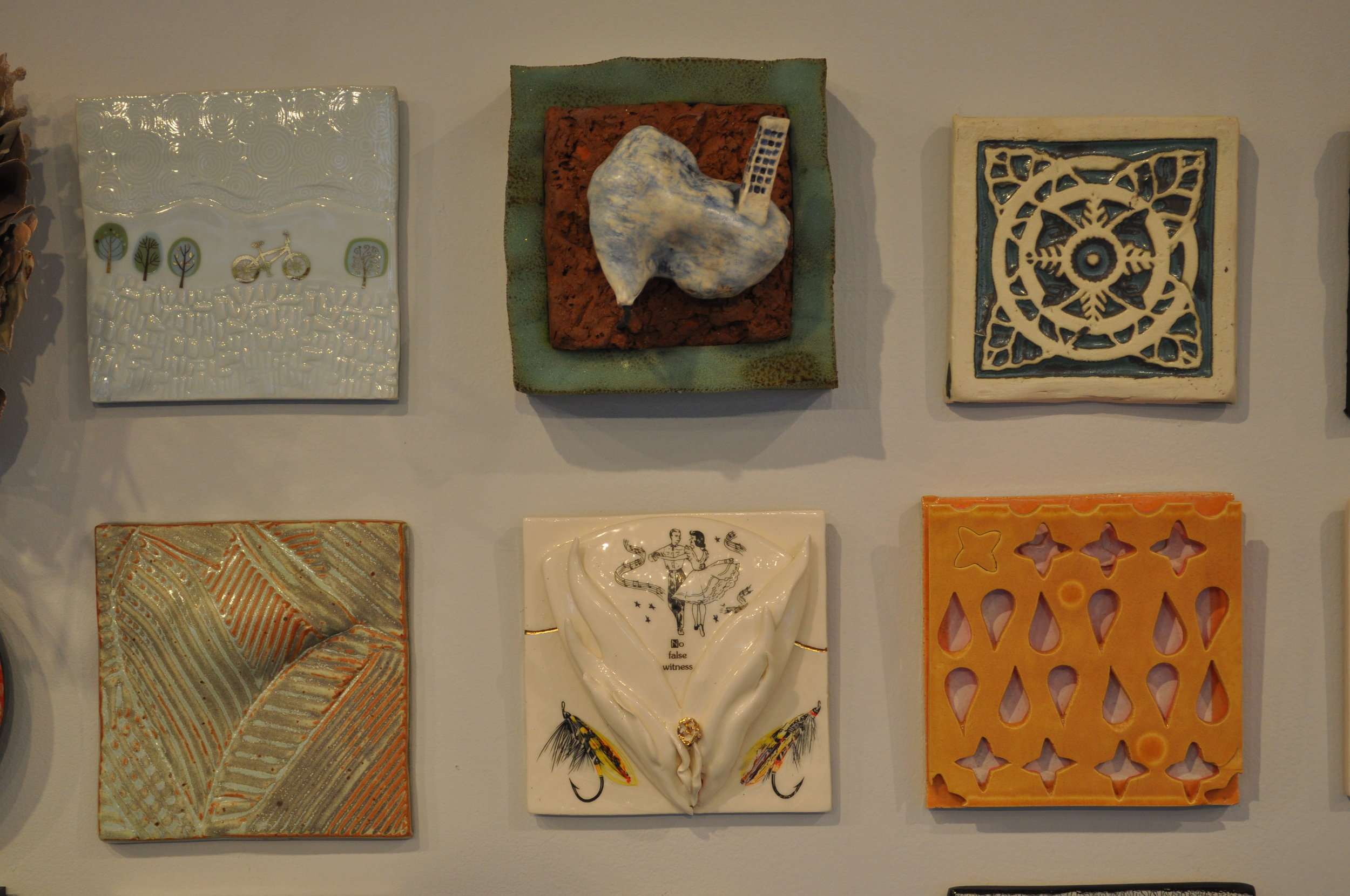 1.  Loren Maron,  White Tile With Bicycle  $95  2 . Rick Parsons,  High-Rise  $200  3 . Sana Musasama,  Tile 1 $80  4. Peter Arnow,  Untitled $50  5.  Anne Mulford,  Alluring  $125  6.  Susan Tunick,  Tan Hald $350