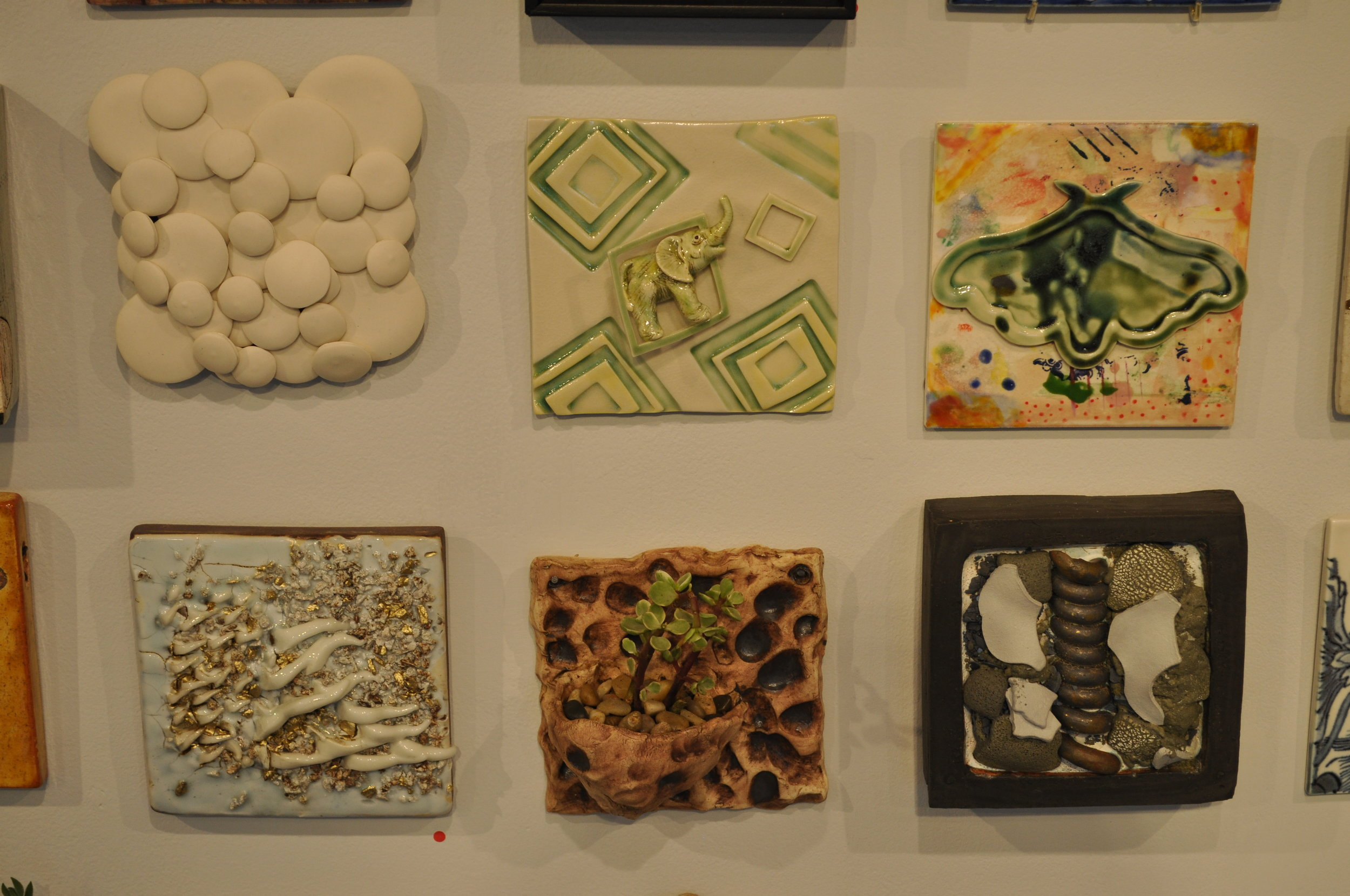1.  Tabbatha Henry,  Clouds (White)  $125  2 . Sally Ng,  Green Sqaures  $65  3.  Adam Chau,  I Wore Green To The Party  $60  4. Deborah Lecce,  Golden Cone Tile  (SOLD) 5.  Leigh Taylor Mickelson,  Tile Planter  $70  6.  John Britt,  Post Neolithic  (SOLD)