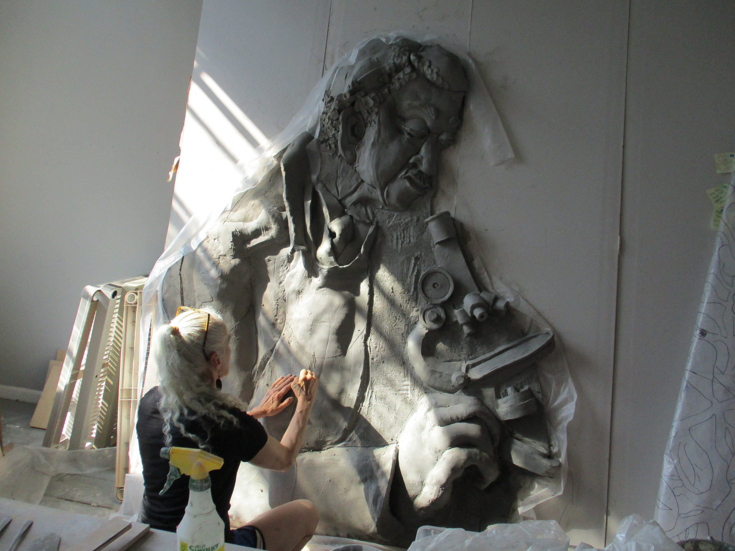 Artist Sarah Cobble sculpting the nearly 7 foot figure of George Washington Carver